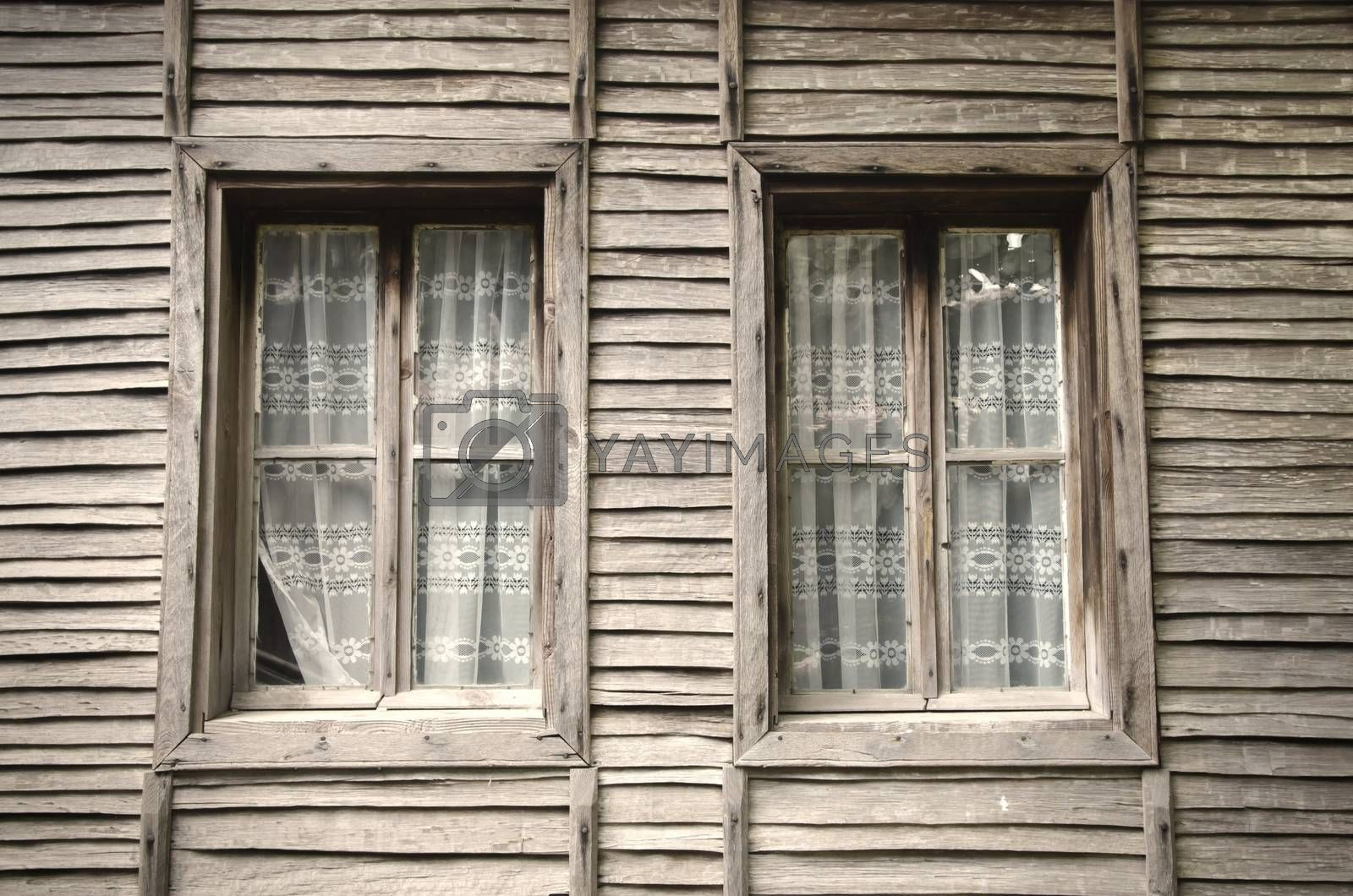 Two Old Windows at Wooden Vintage Wall