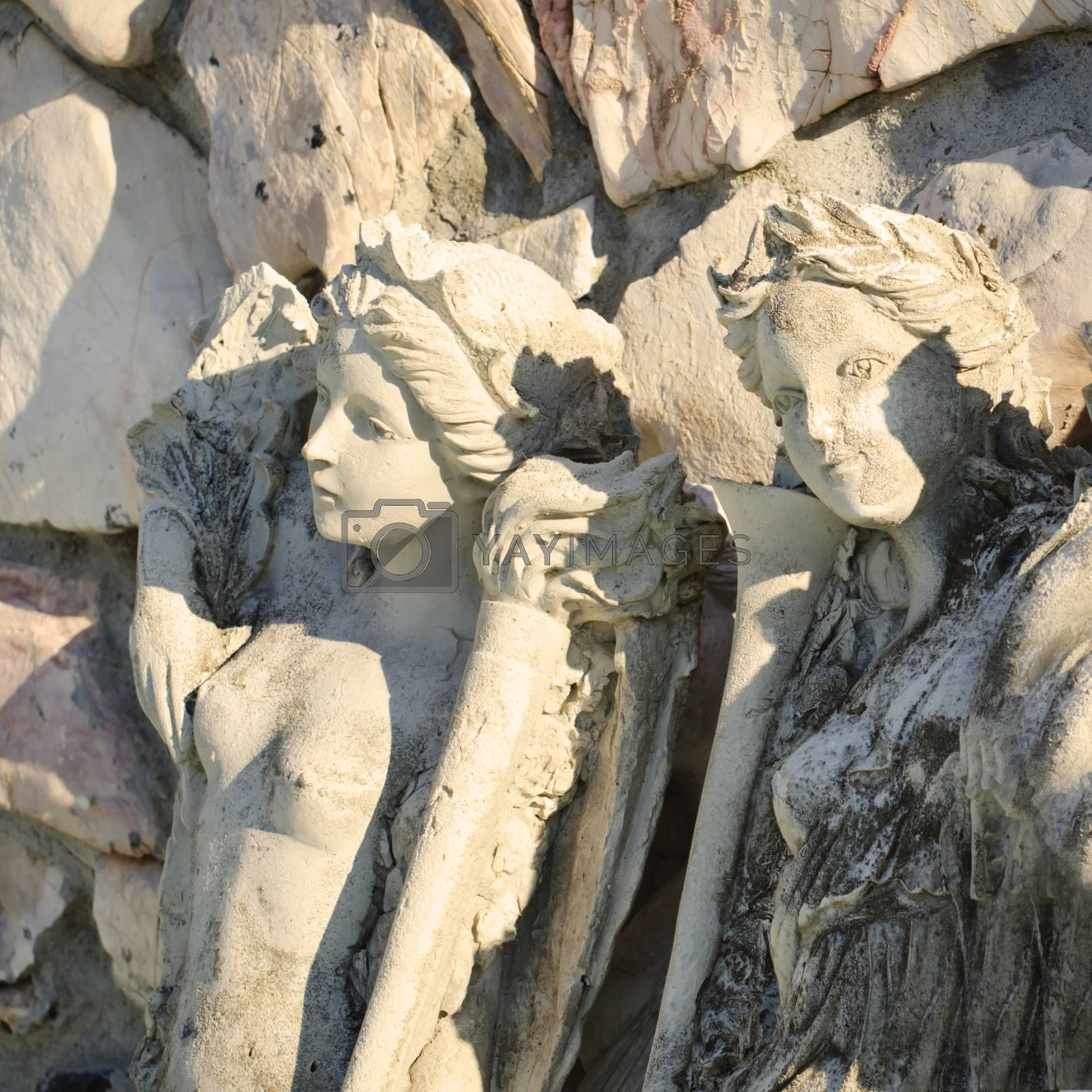Photo of the Vintage Old Woman Stone Sculptures