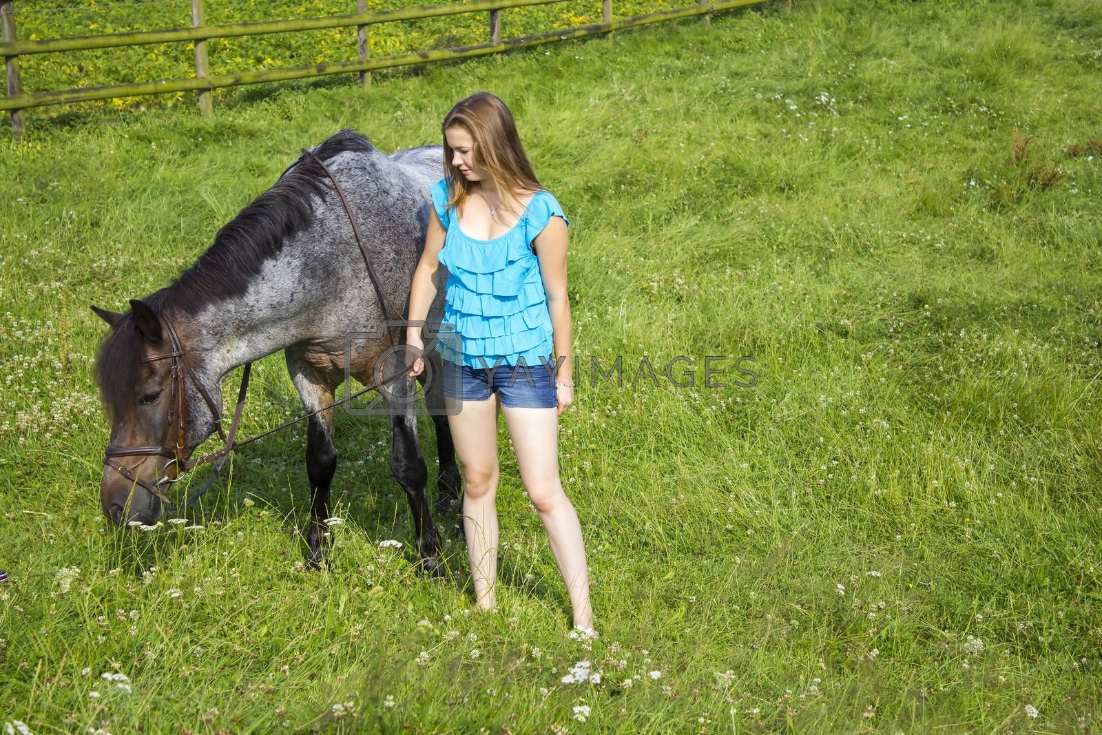 Royalty free image of young girl and her horse by miradrozdowski