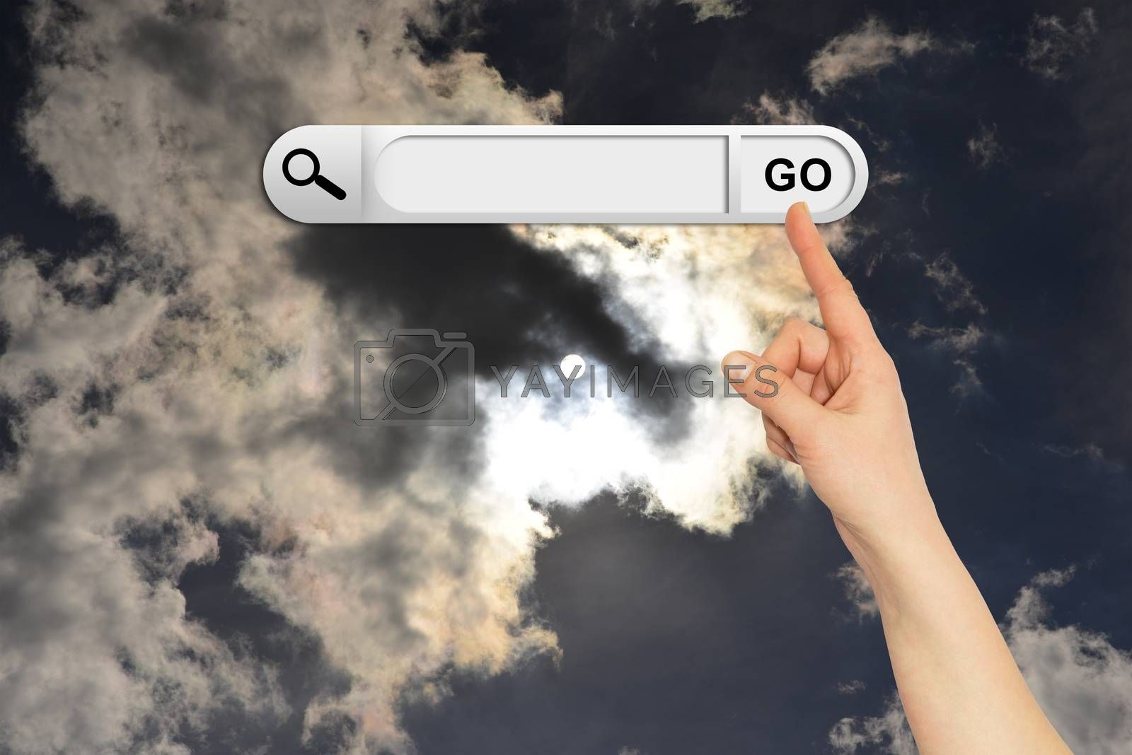 Human hand indicates the search bar in browser. Sunset or sunrise on background