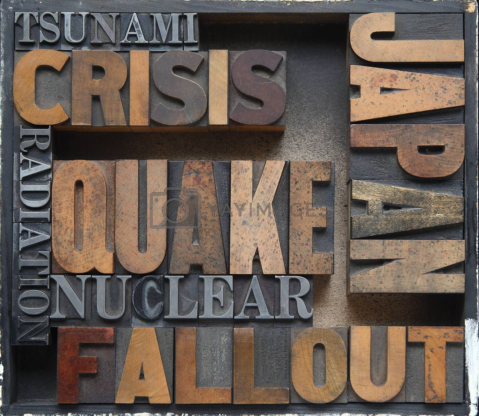 words related to Japan's earthquake, tsunami and nuclear disasters in old wood and metal type