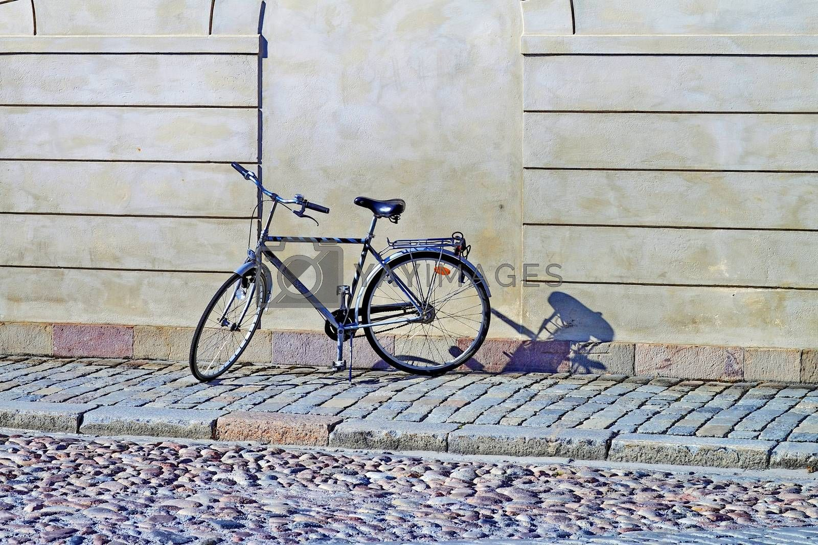 Royalty free image of bike on the street by victorych