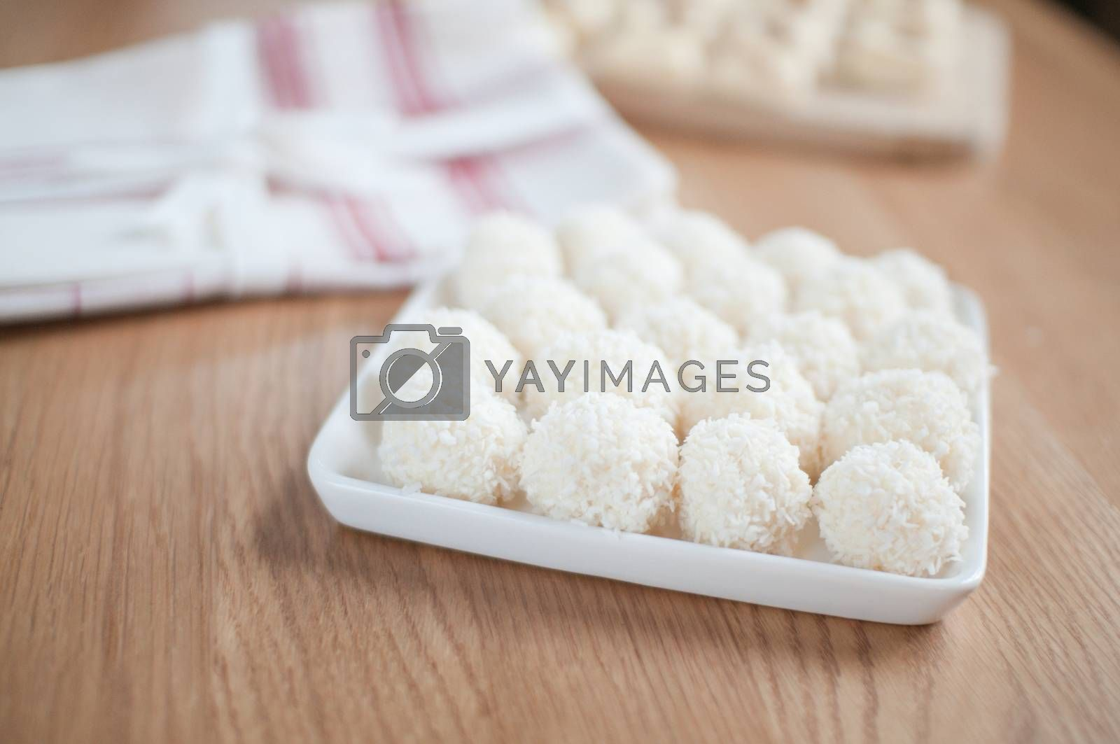 Coco balls in plate on the wooden table