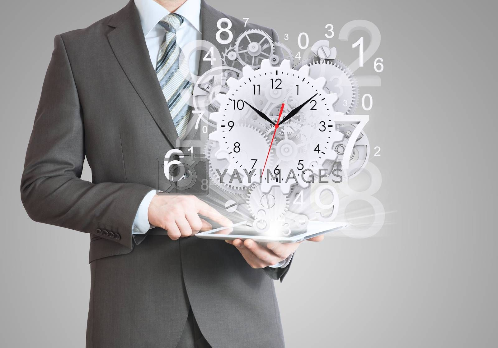 Businessman hold tablet pc with clock and gears. Gray background