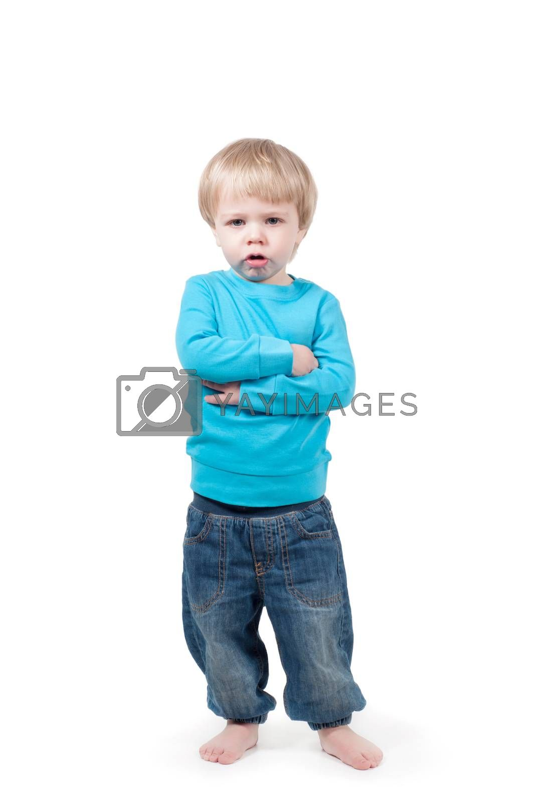 Portrait of a serious boy with crossed arms looking at camera