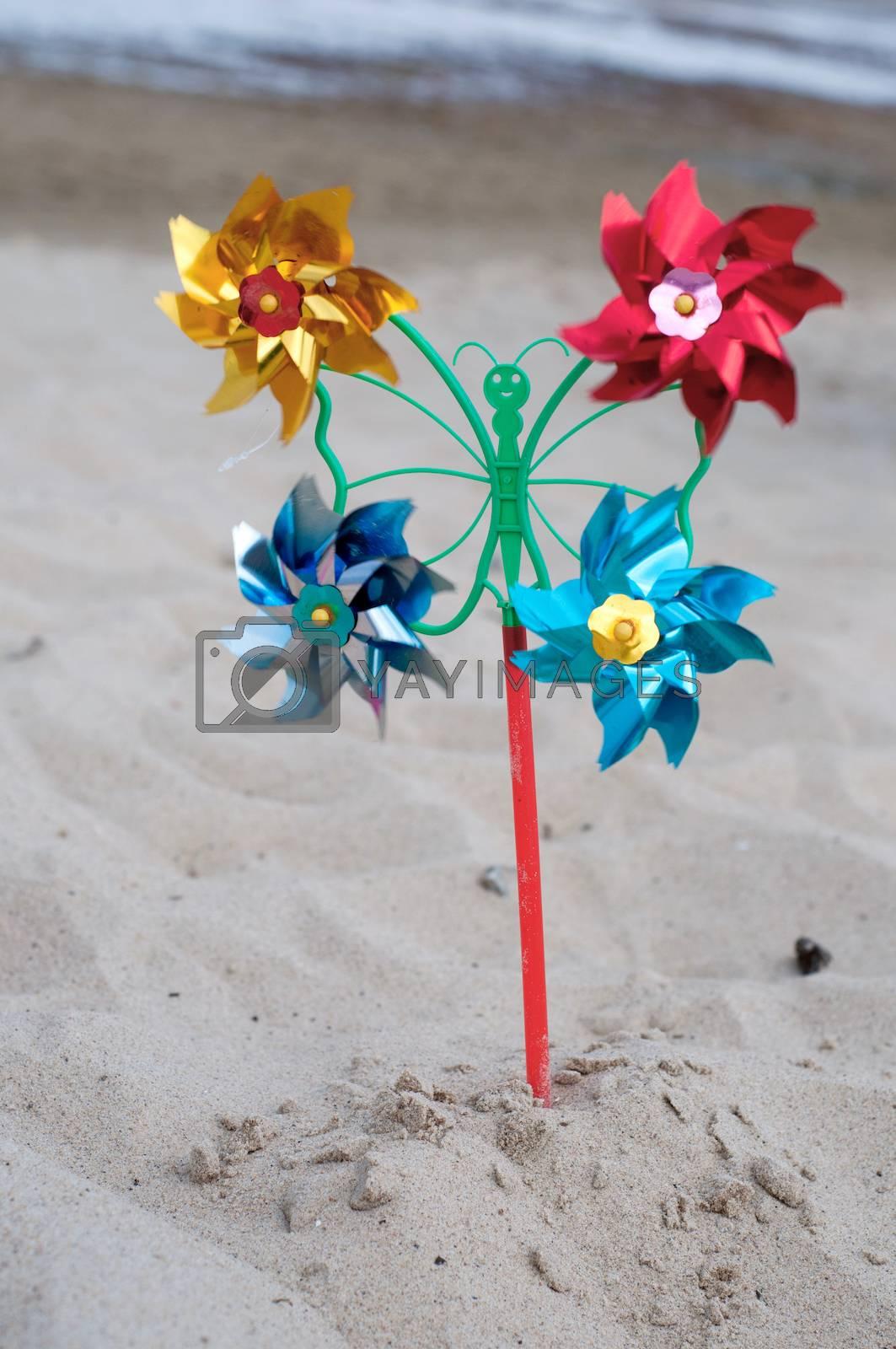 Shot of pinwheel toy on the sandy background