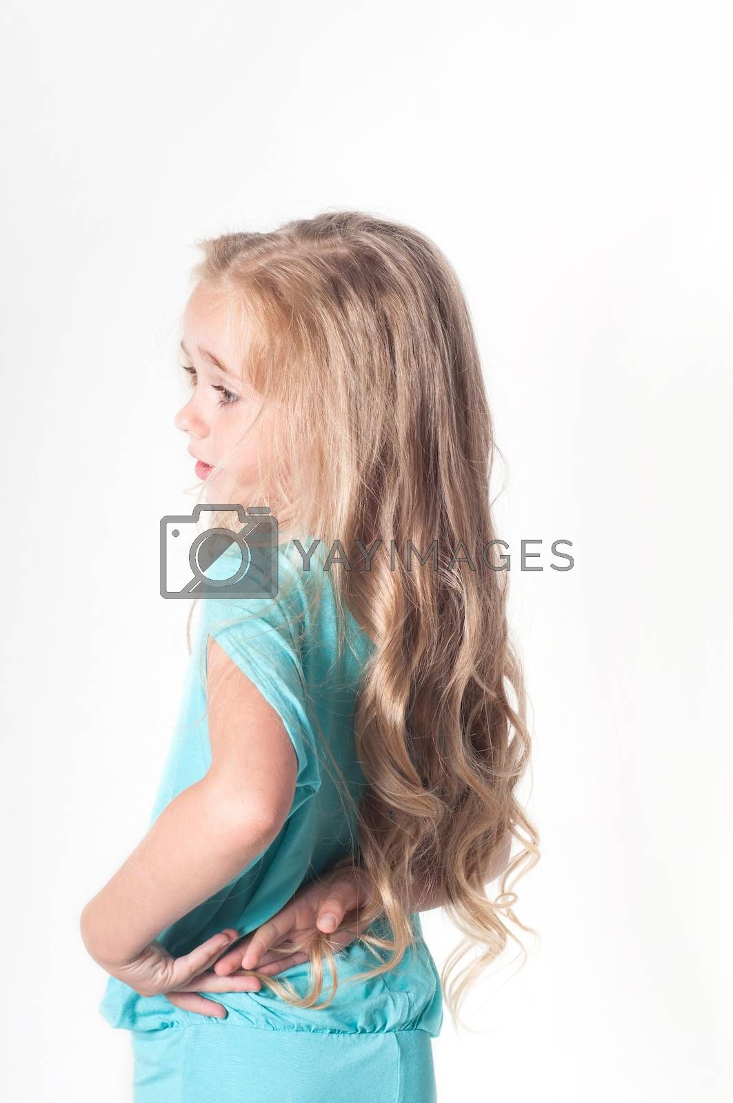 Photo from the back of little girl in blue dress