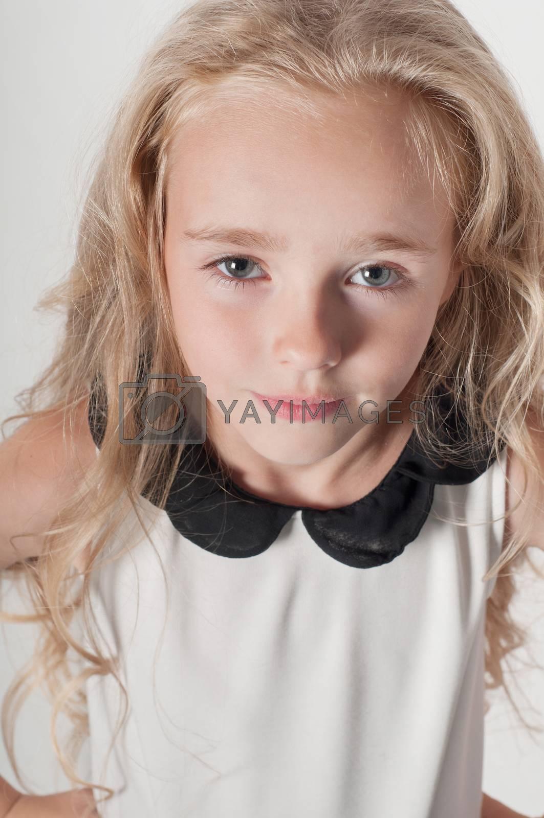 Pretty little girl in white white in studio