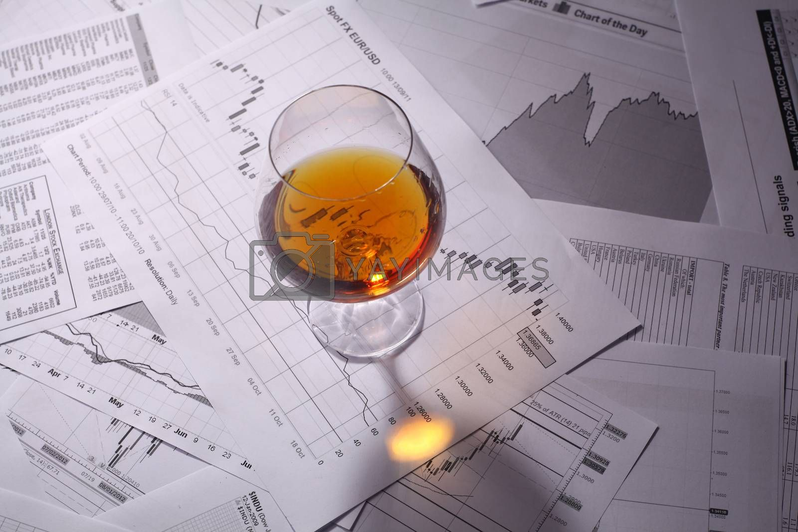 Royalty free image of Brandy on charts by hiddenhallow