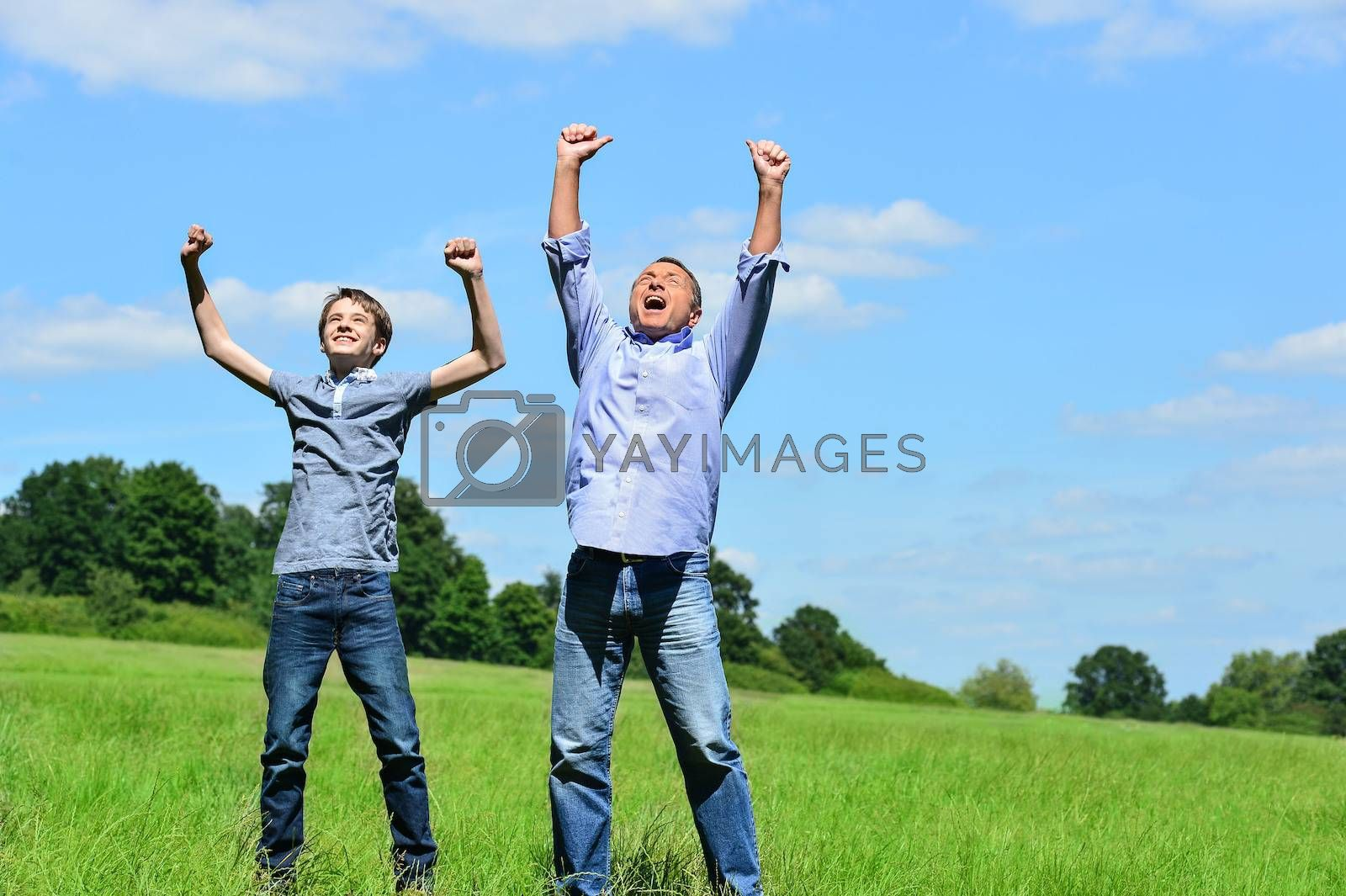 Father and son rejoicing in the park