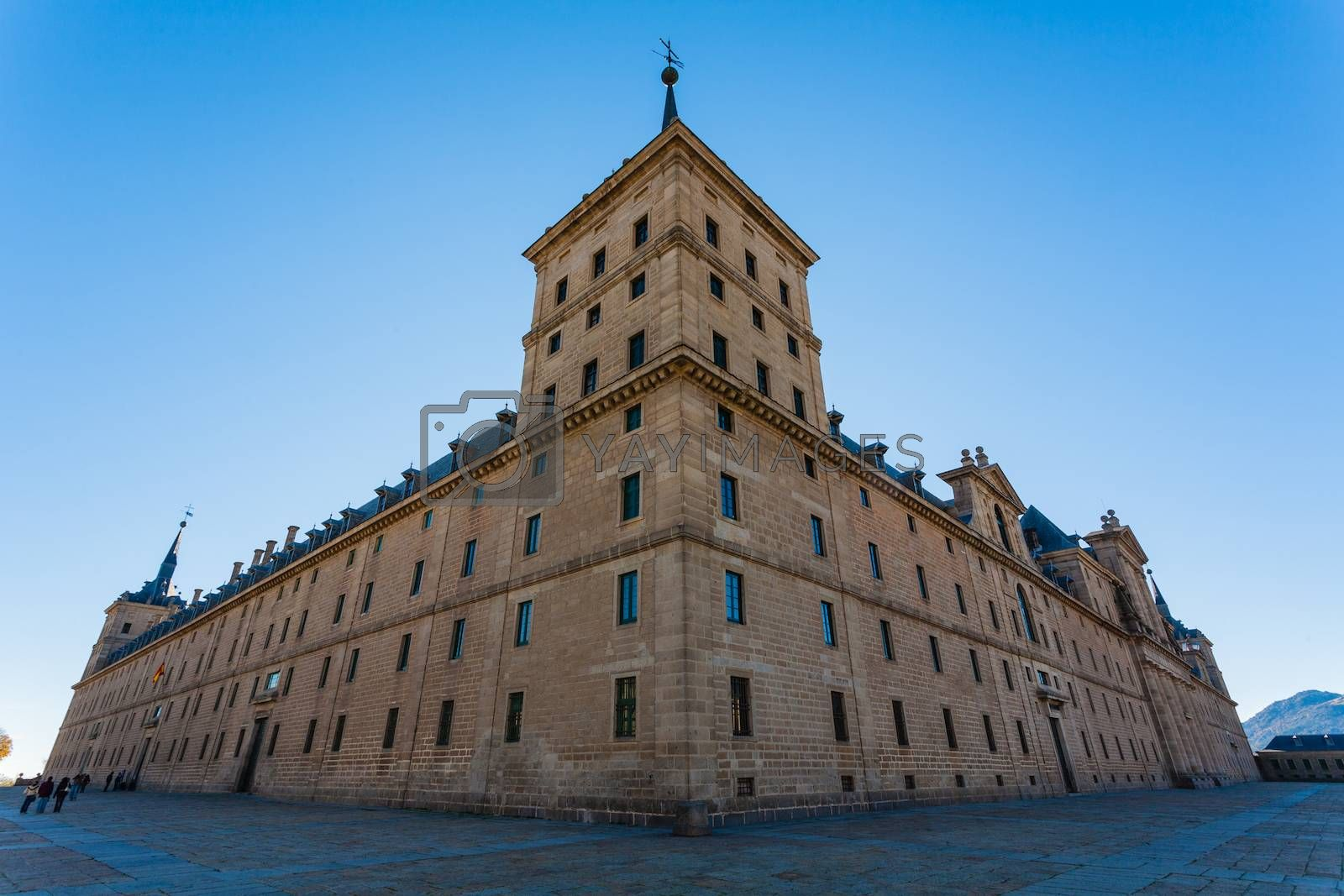 Full view of San Lorenzo de El Escorial Royal Site  taken from the big outdoors square showing its enormous architectural structure , Madrid Spain