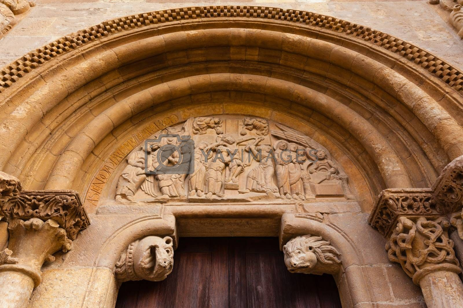 Carved tympanum  detail view of the romanesque style door  called Puerta del Cordero in the Royal San Isidoro collegiate church from the X century i n Leon Spain