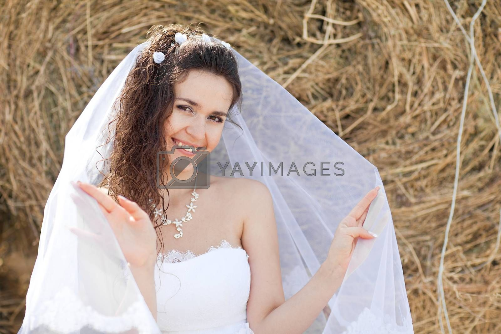 happy bride near hay