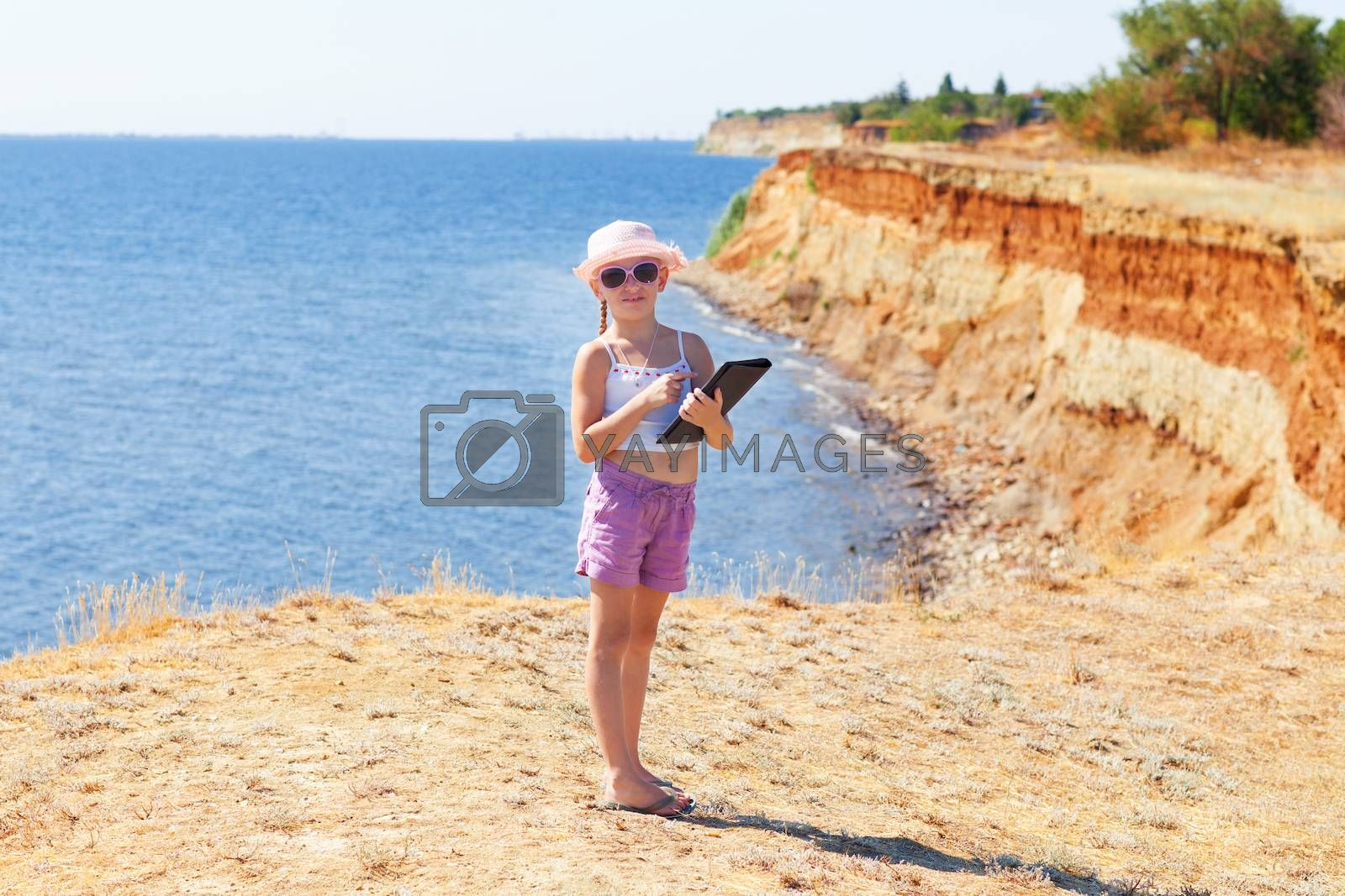 girl on the beach with laptop