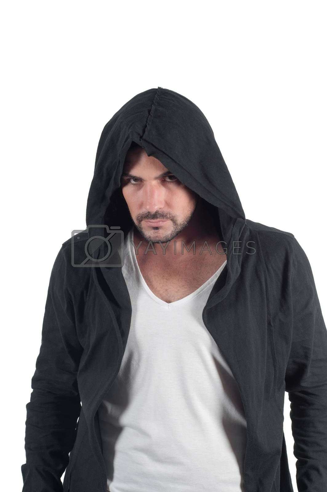 A male in a hood looks askance menacingly