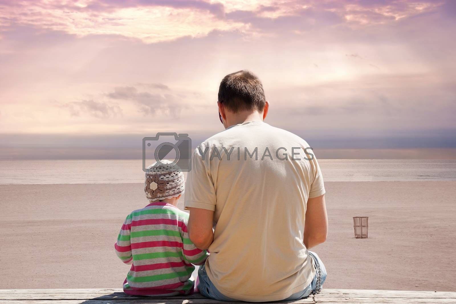 Father and daughter on empty beach at sunset. by eskymaks
