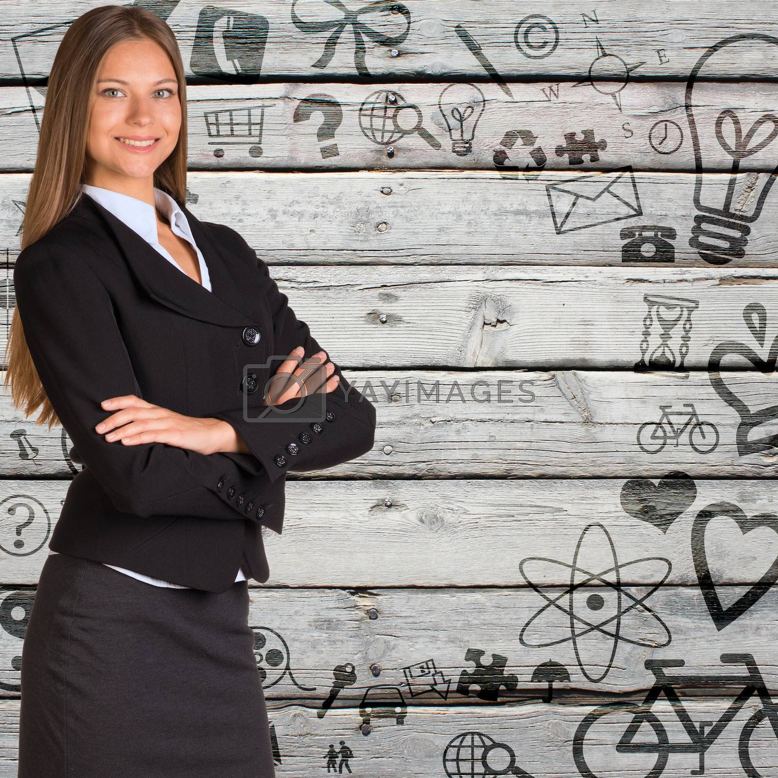 Businesswoman in a suit with background of various social icons on old wooden surface. Stylised frame