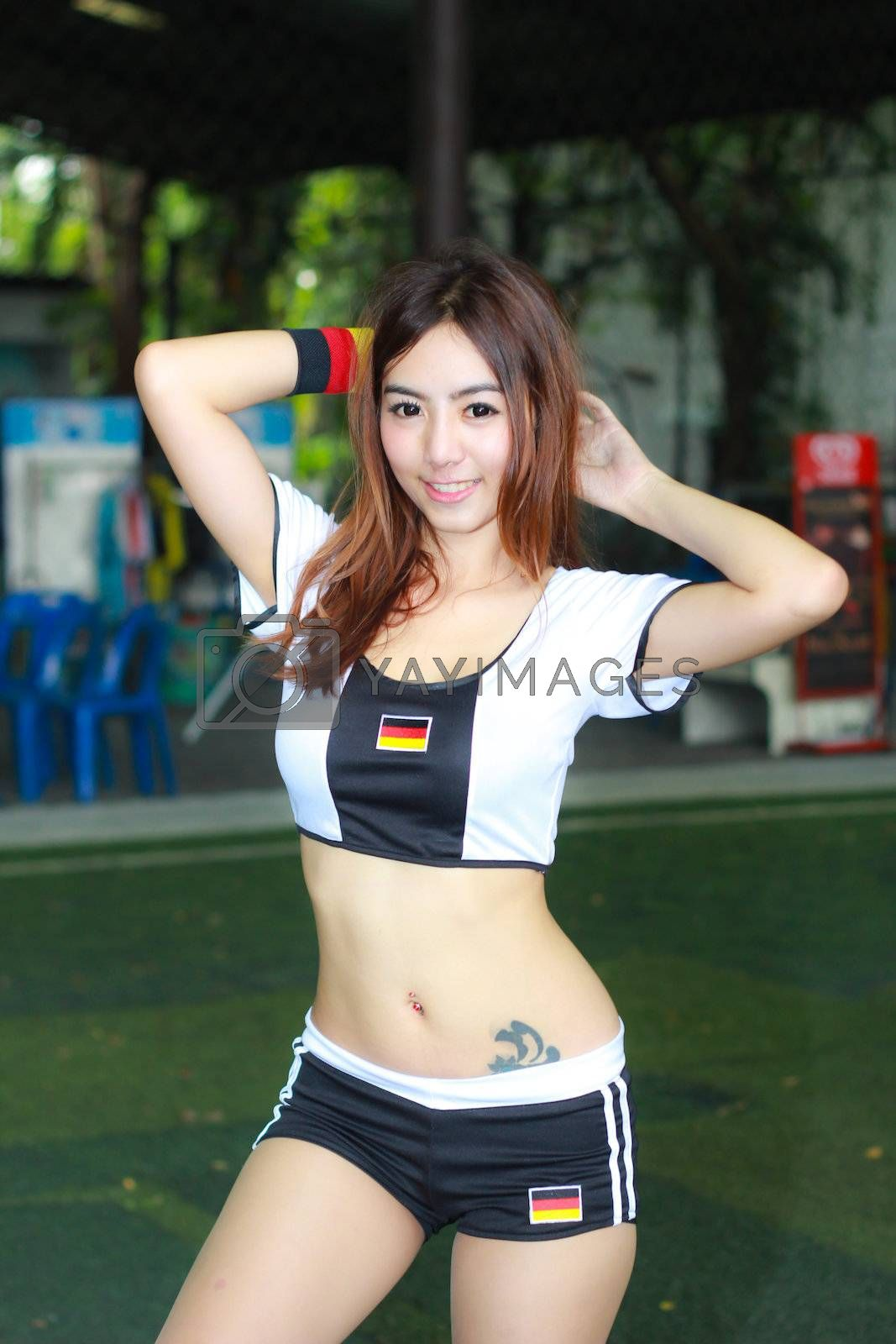 BANGKOK, THAILAND - JUNE 29, 2014: Unidentified model with Germany  costume pose for promote World Cup 2014 in futsal park on June 29, 2014 in Bangkok, Thailand.