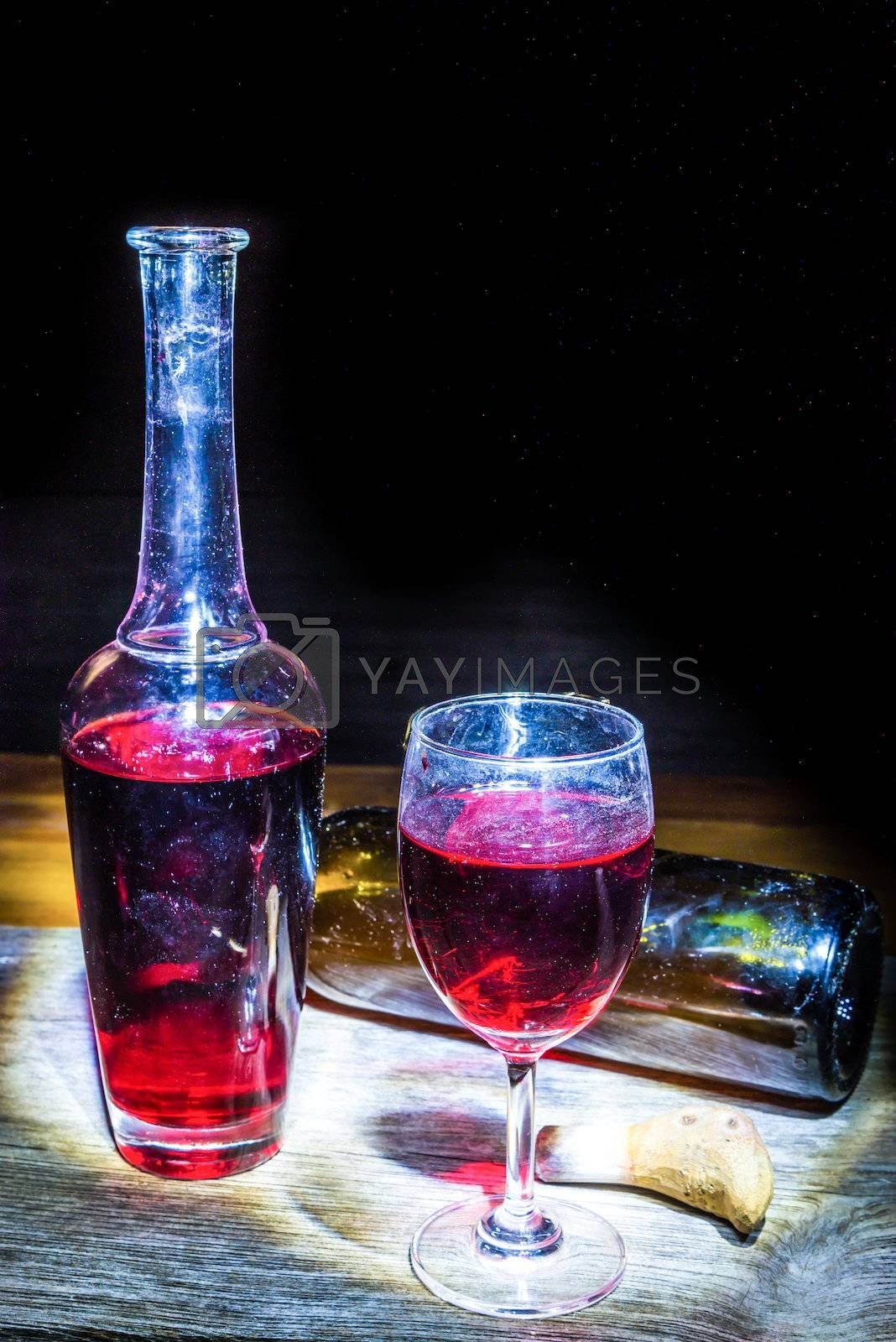 still life Wine glass and Bottle on a wooden background