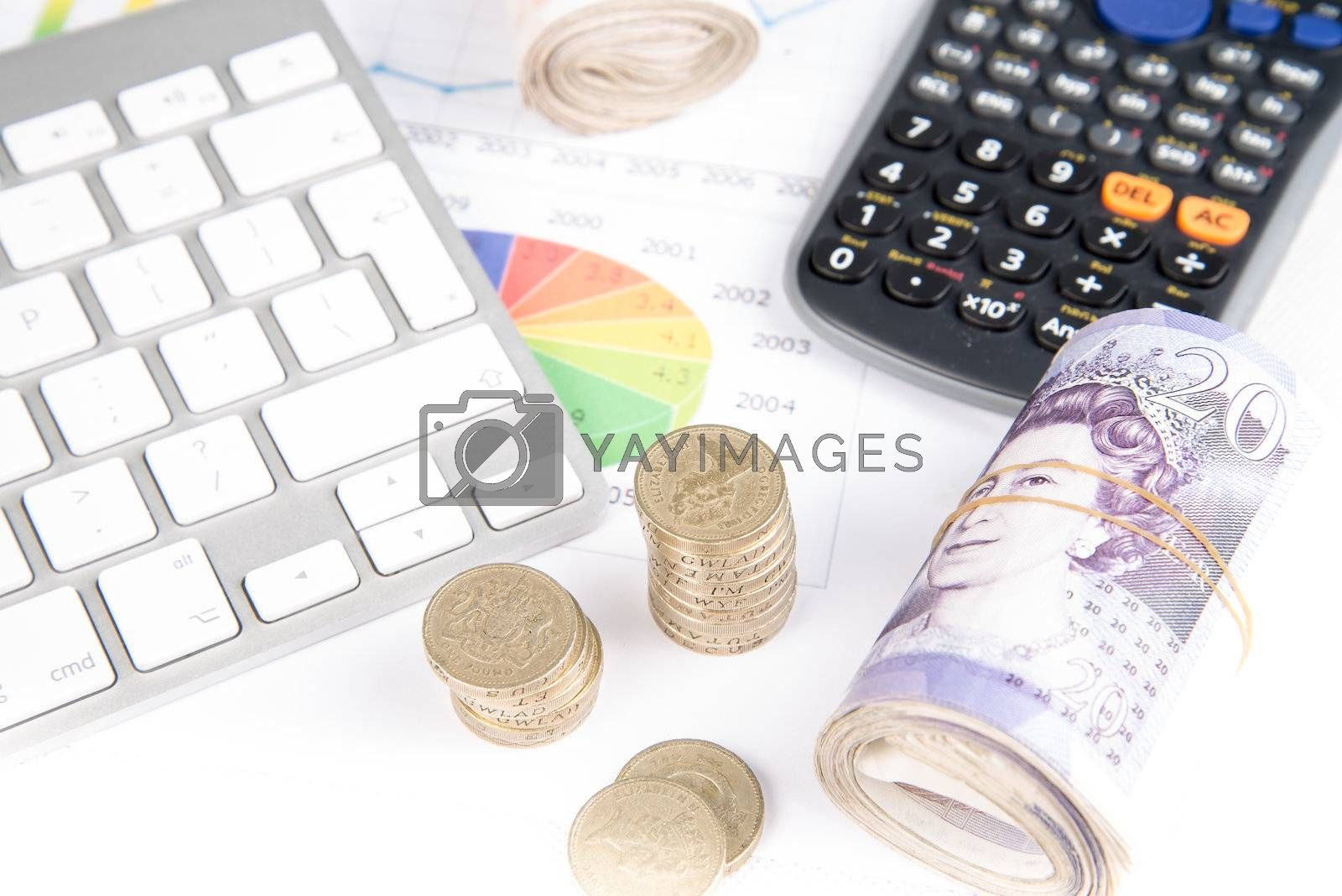 British pound sterling coins and bank notes on desk