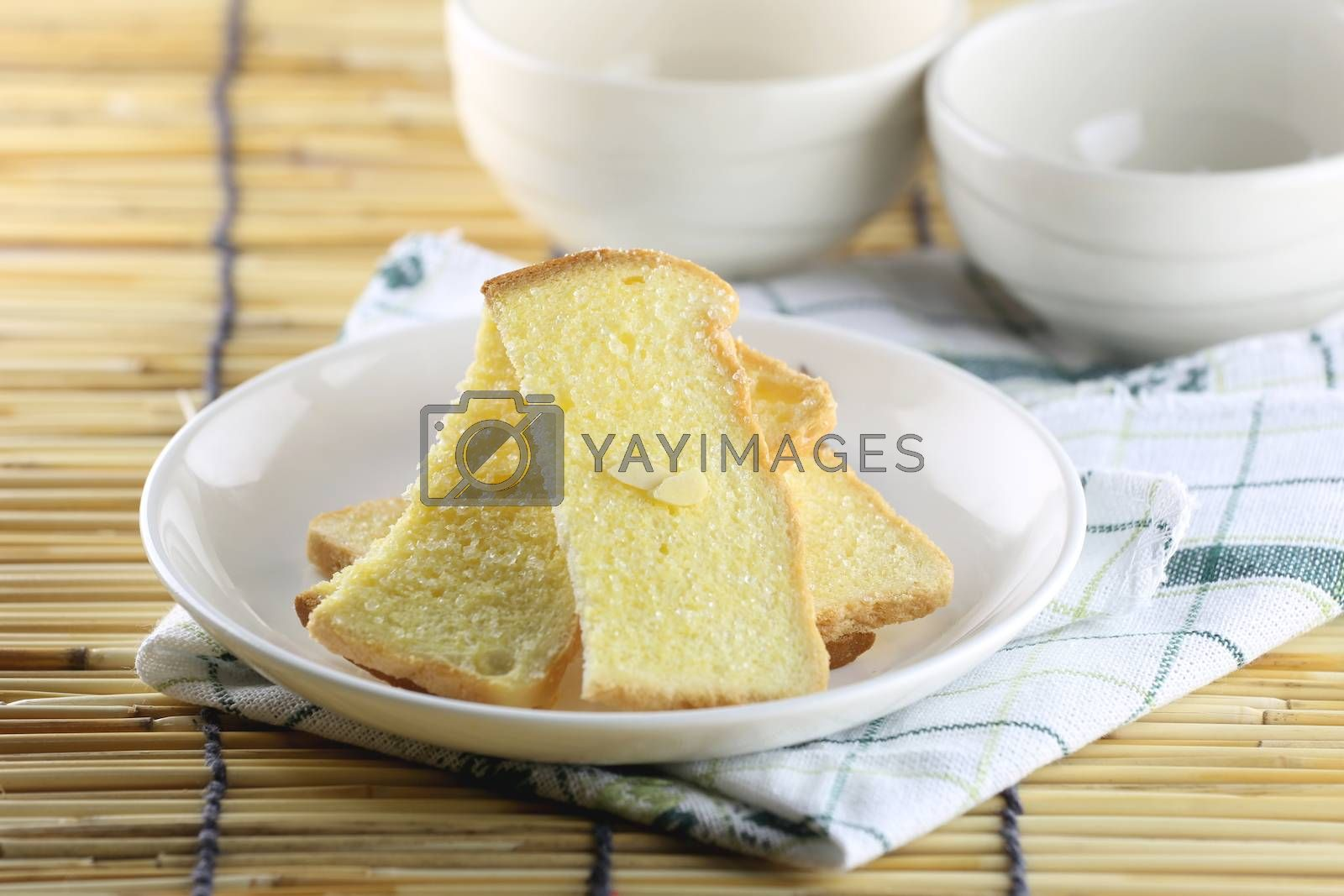 baking bread of butter in white dish.