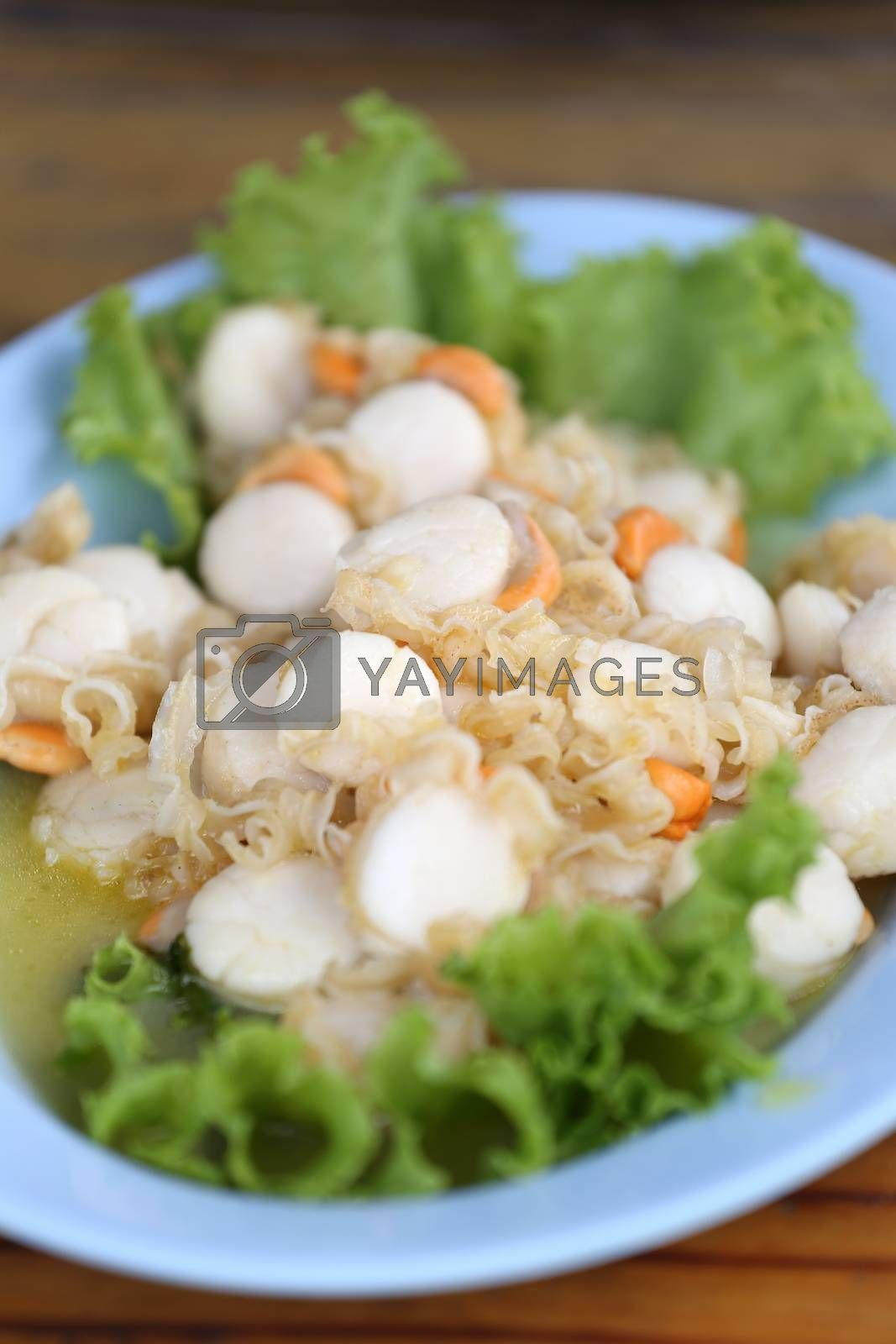 stir fried scallop with butter on dish.