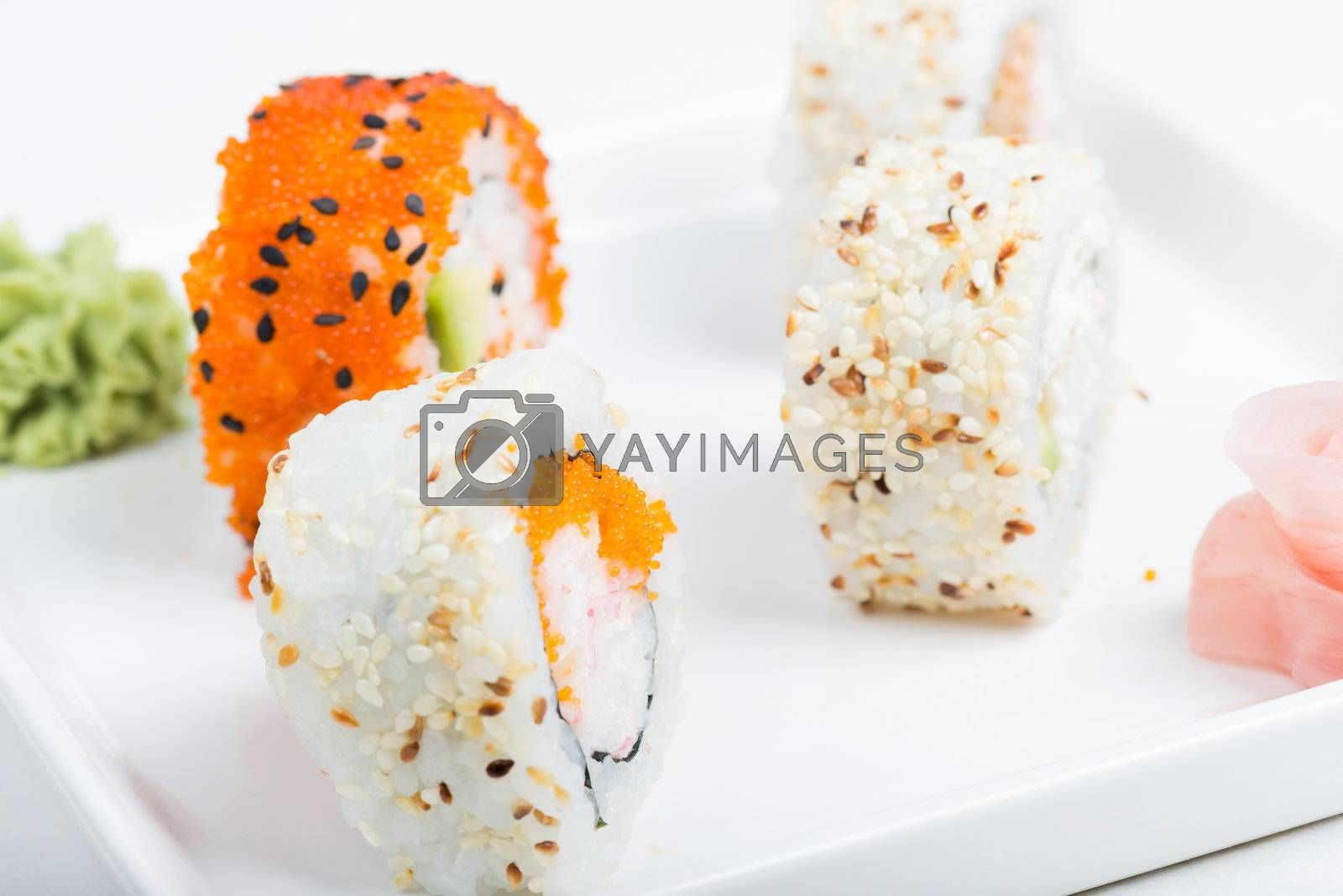 Different shushi rolls on the white plate