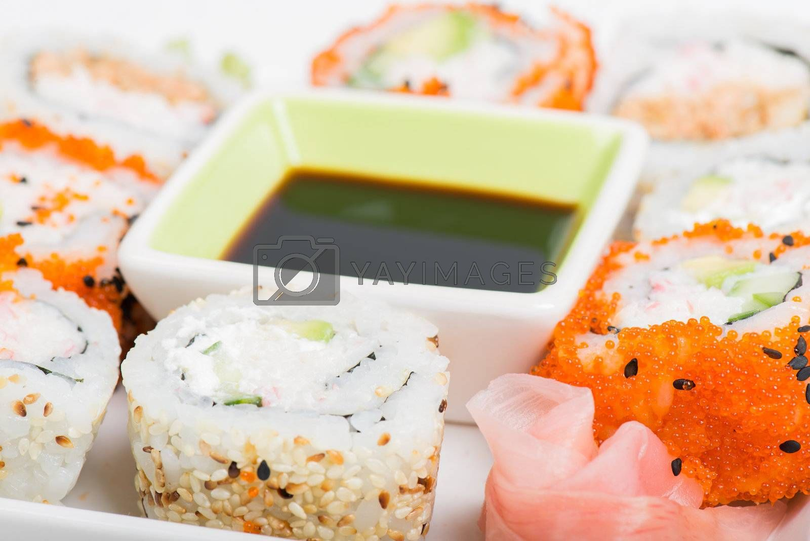 Soy sauce and sushi mix on the plate