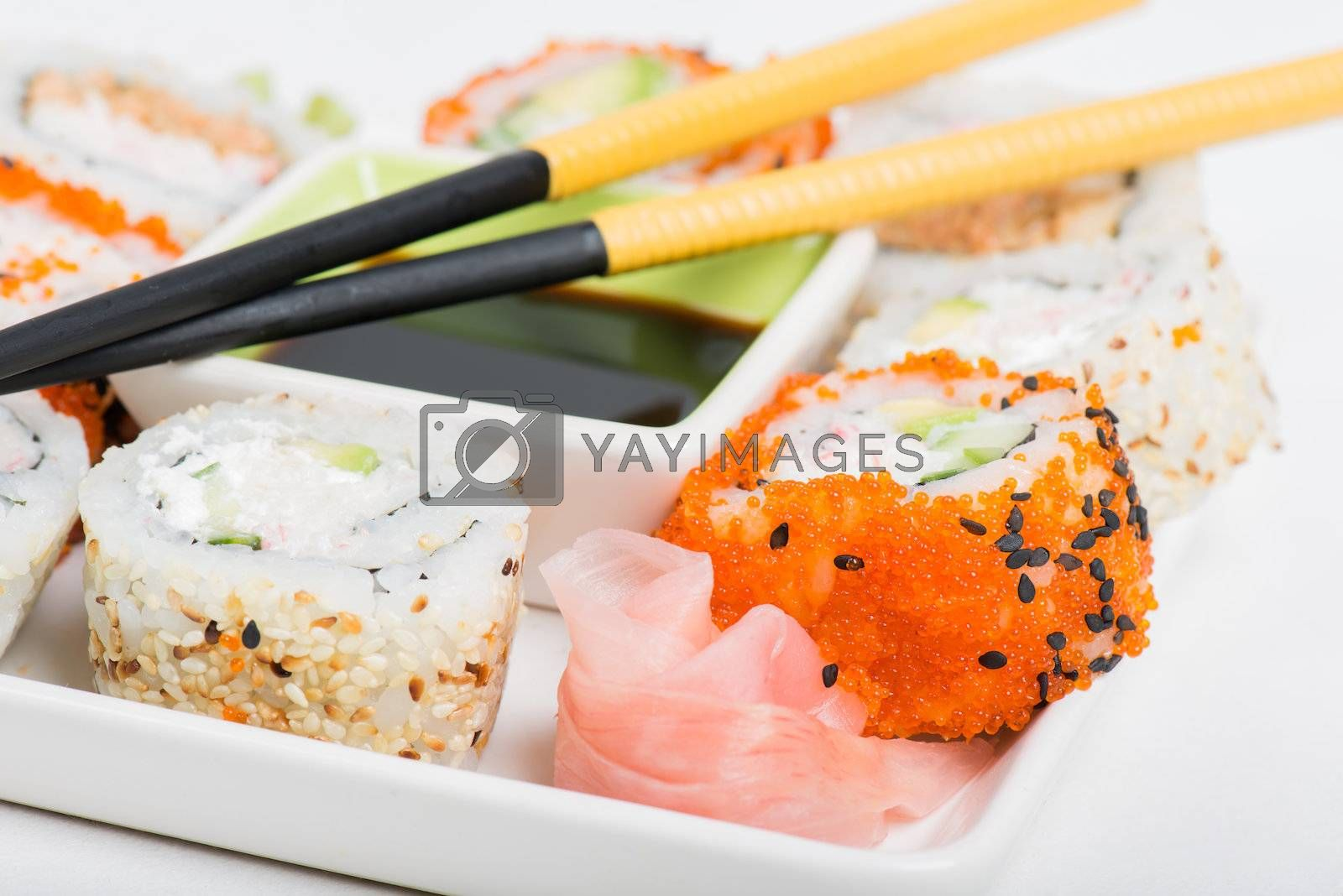 Soy sauce, chopsticks and sushi mix on the plate
