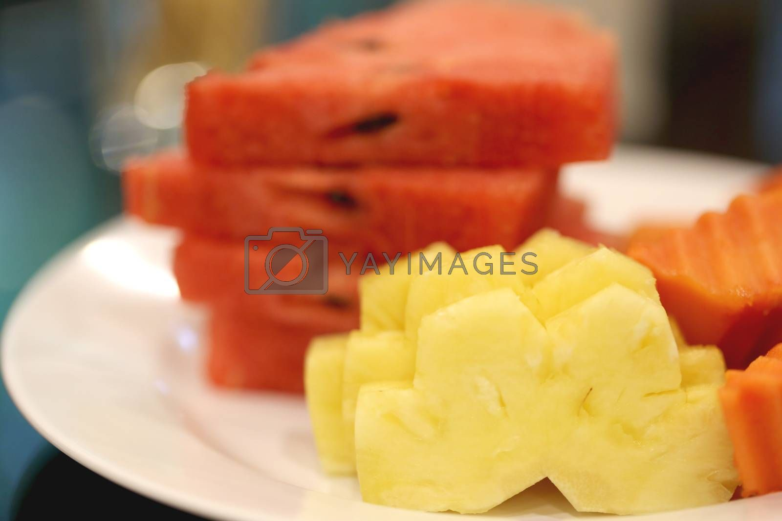Pineapple and watermelon peeling on the white dish.