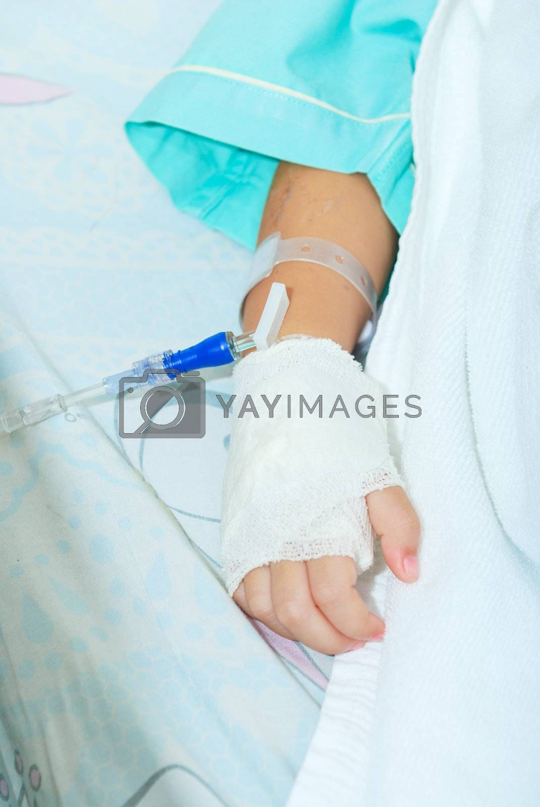 Royalty free image of Hand of sick little girl at hospital by teen00000