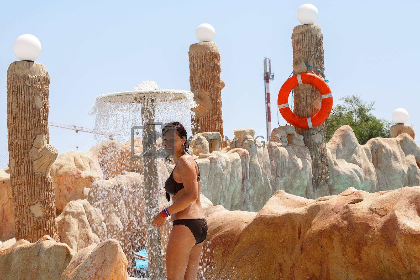 Royalty free image of woman in tunisian aquapark resort under shower by artush