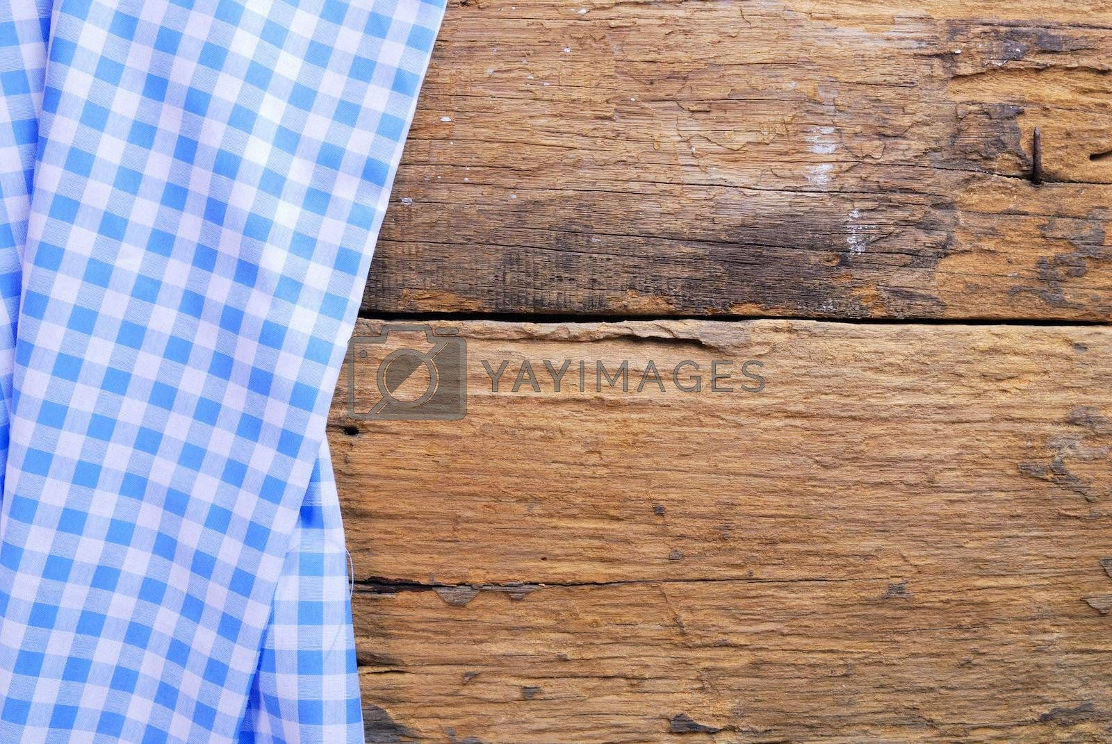 Royalty free image of the background made from checkered napkin on old wooden table by teen00000