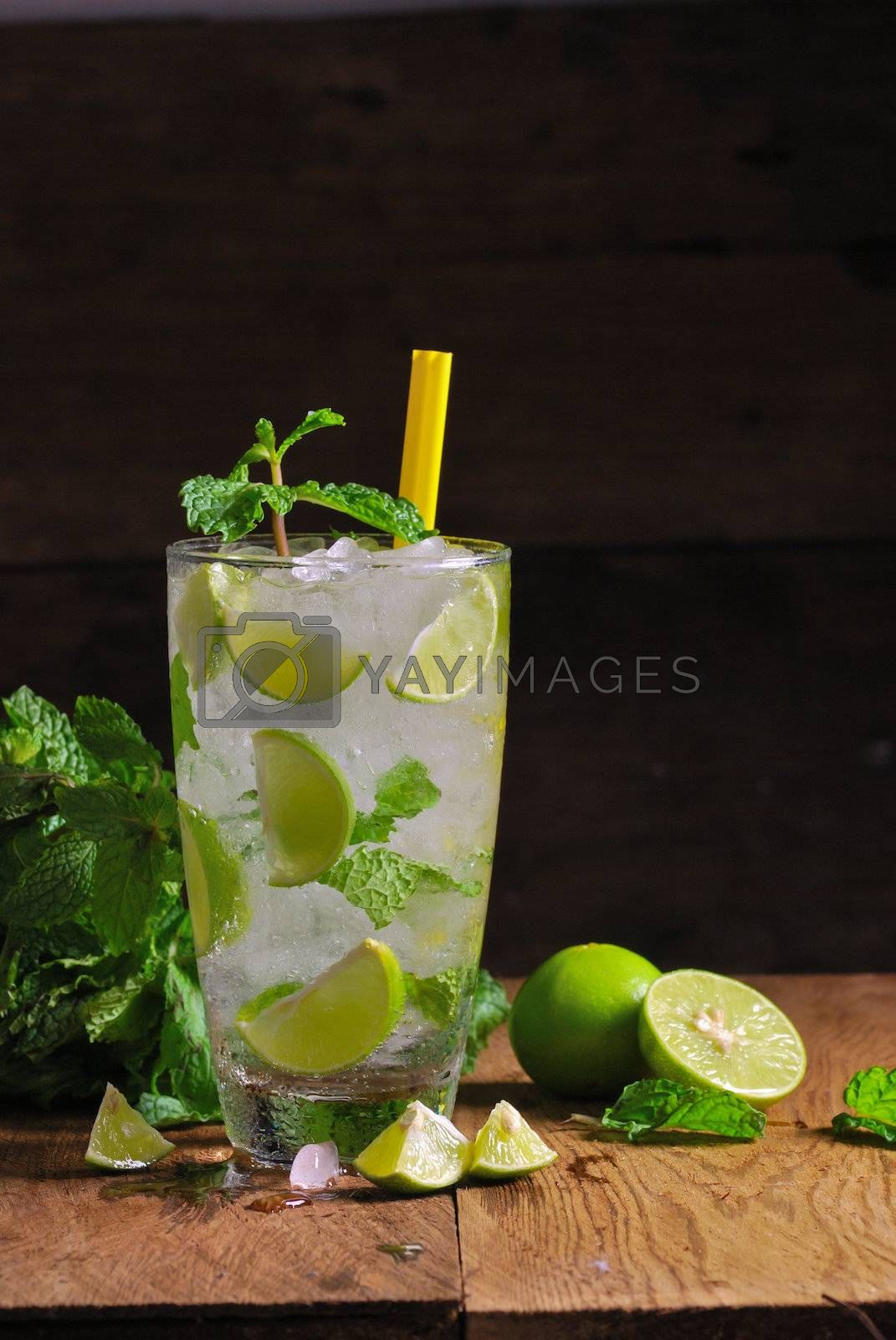 Royalty free image of Mojito , lime pieces , leaves of mint with ice and rum  by teen00000