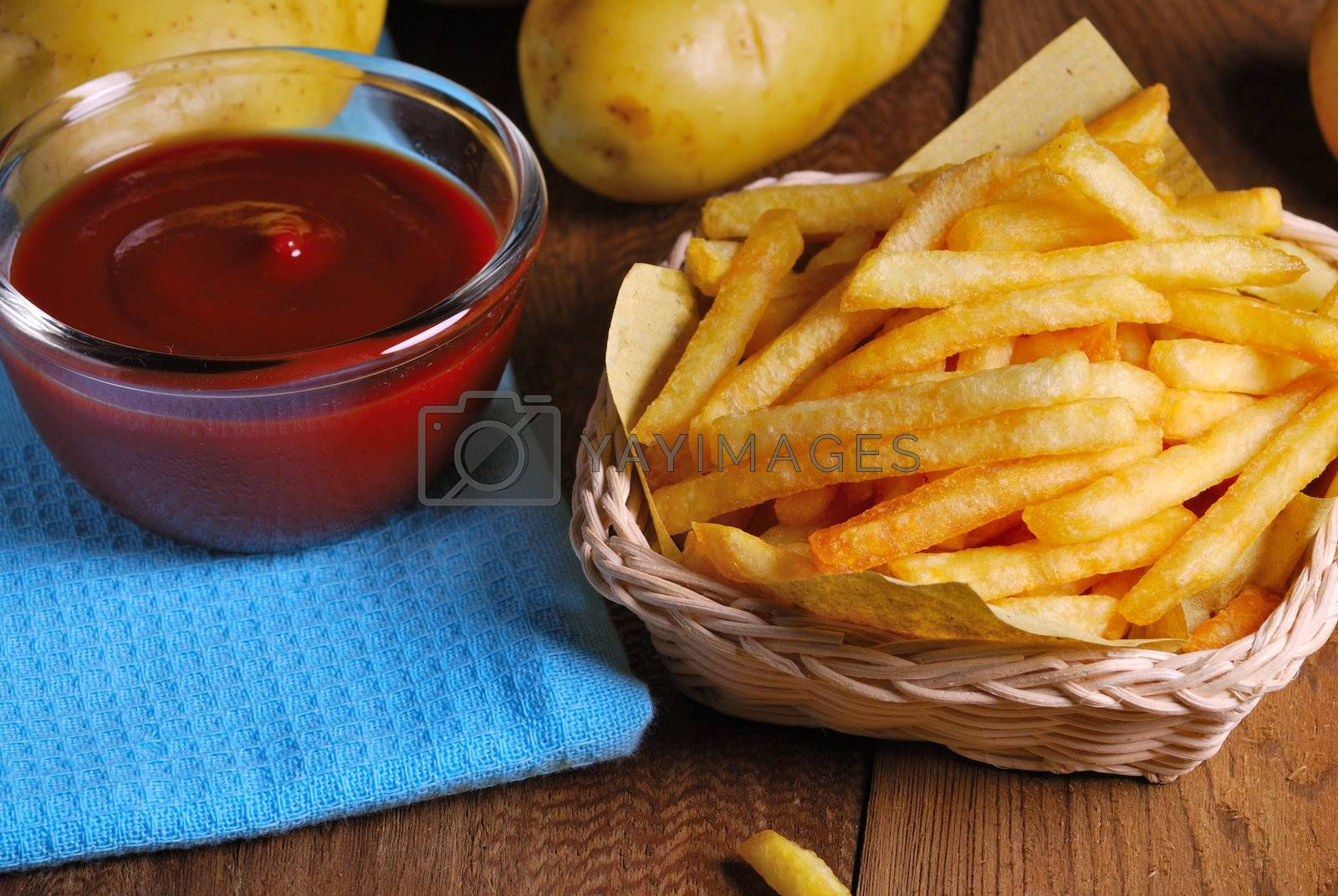 Royalty free image of Traditional French fries with ketchup  by teen00000