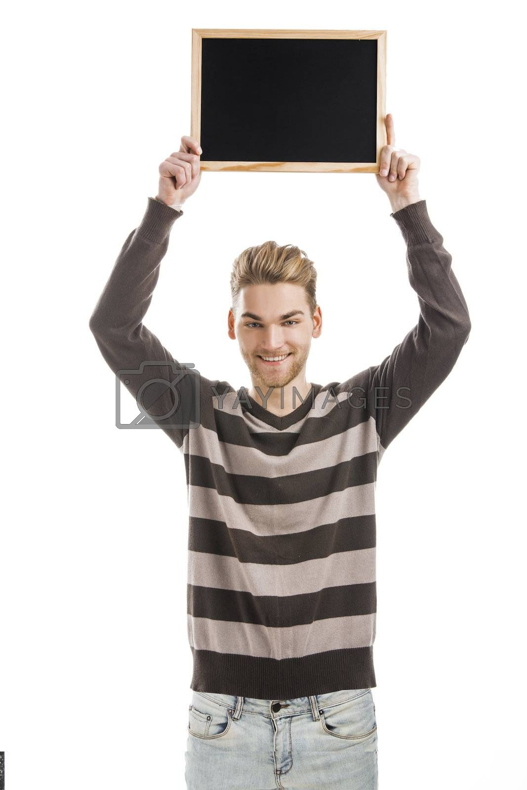 Royalty free image of Man holding a chalkboard by Iko