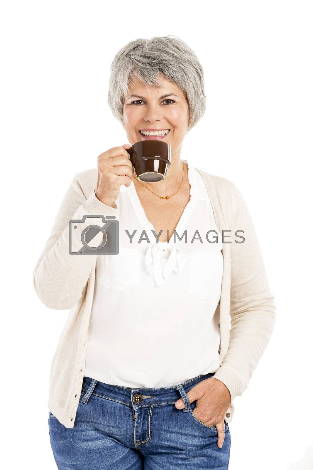 Royalty free image of Elderly woman drinking coffee by Iko