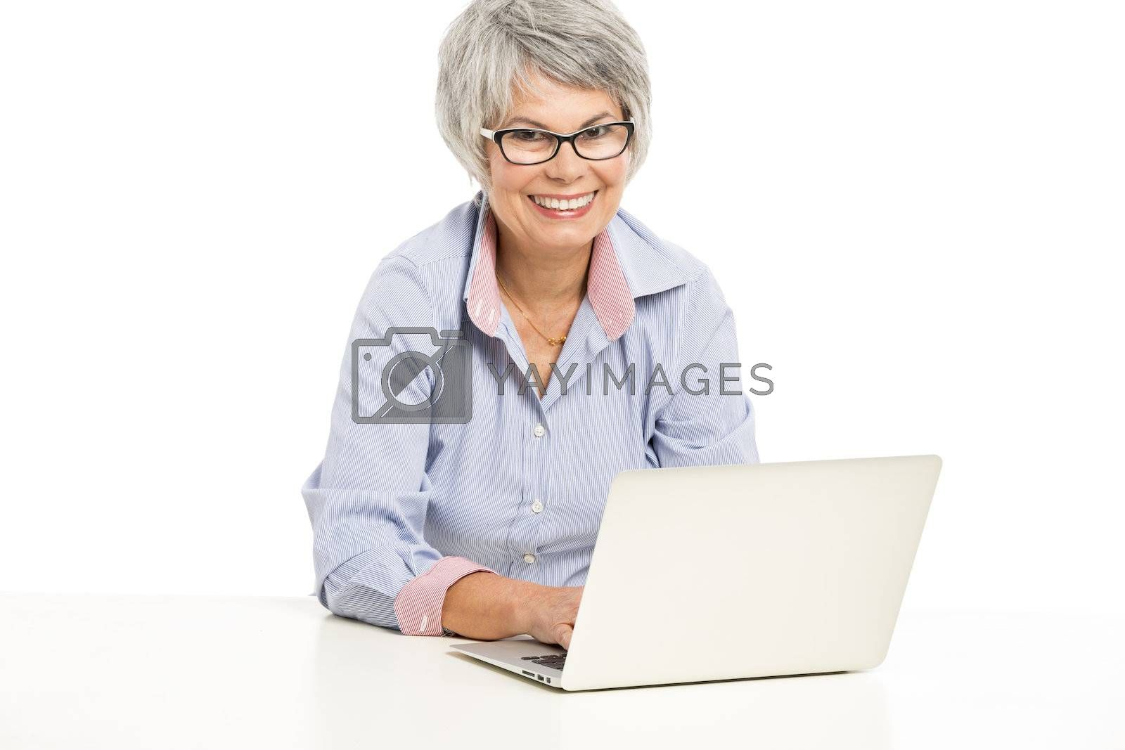 Royalty free image of Ellderly woman working with a laptop by Iko