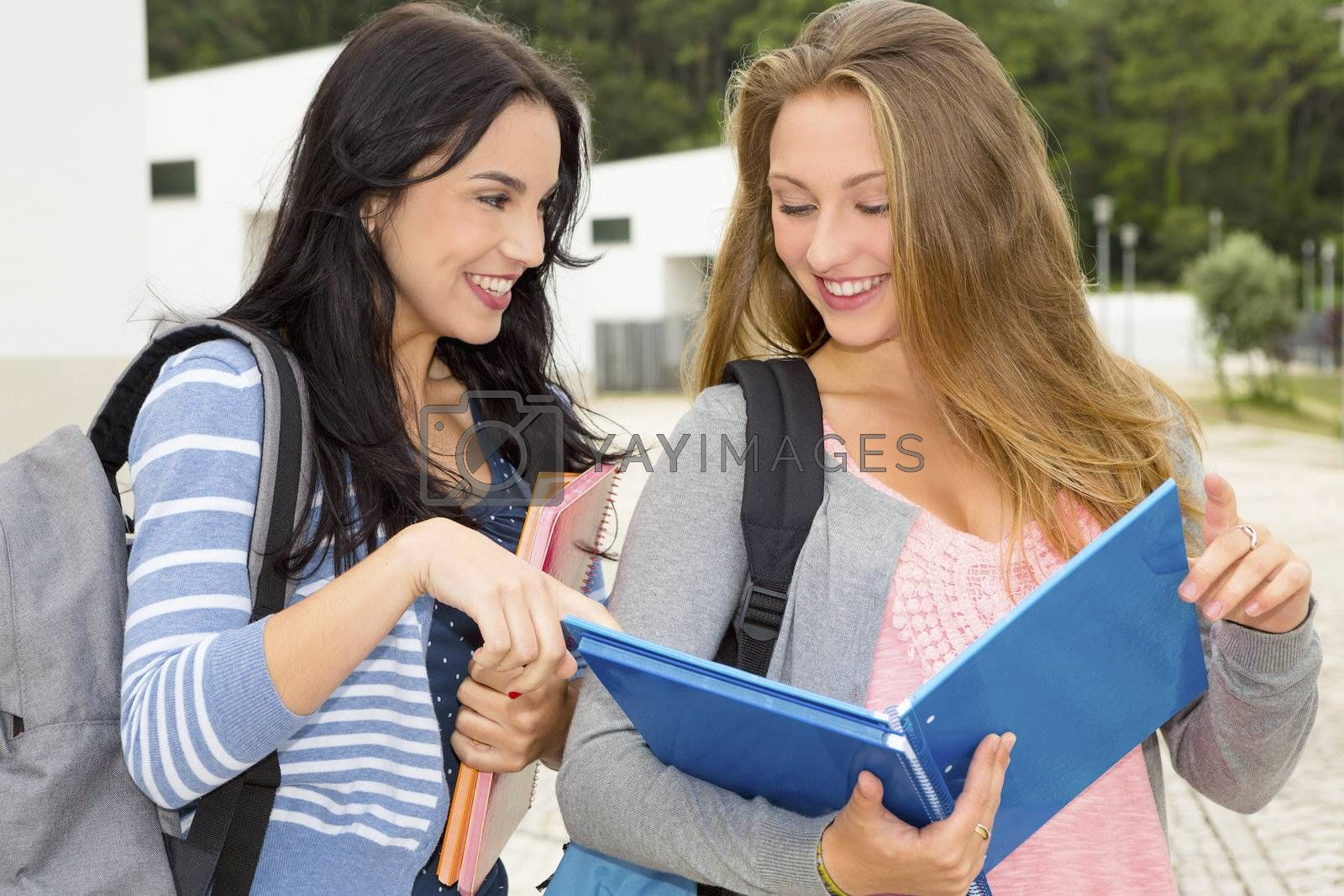 Royalty free image of Two beautiful teenage students by Iko