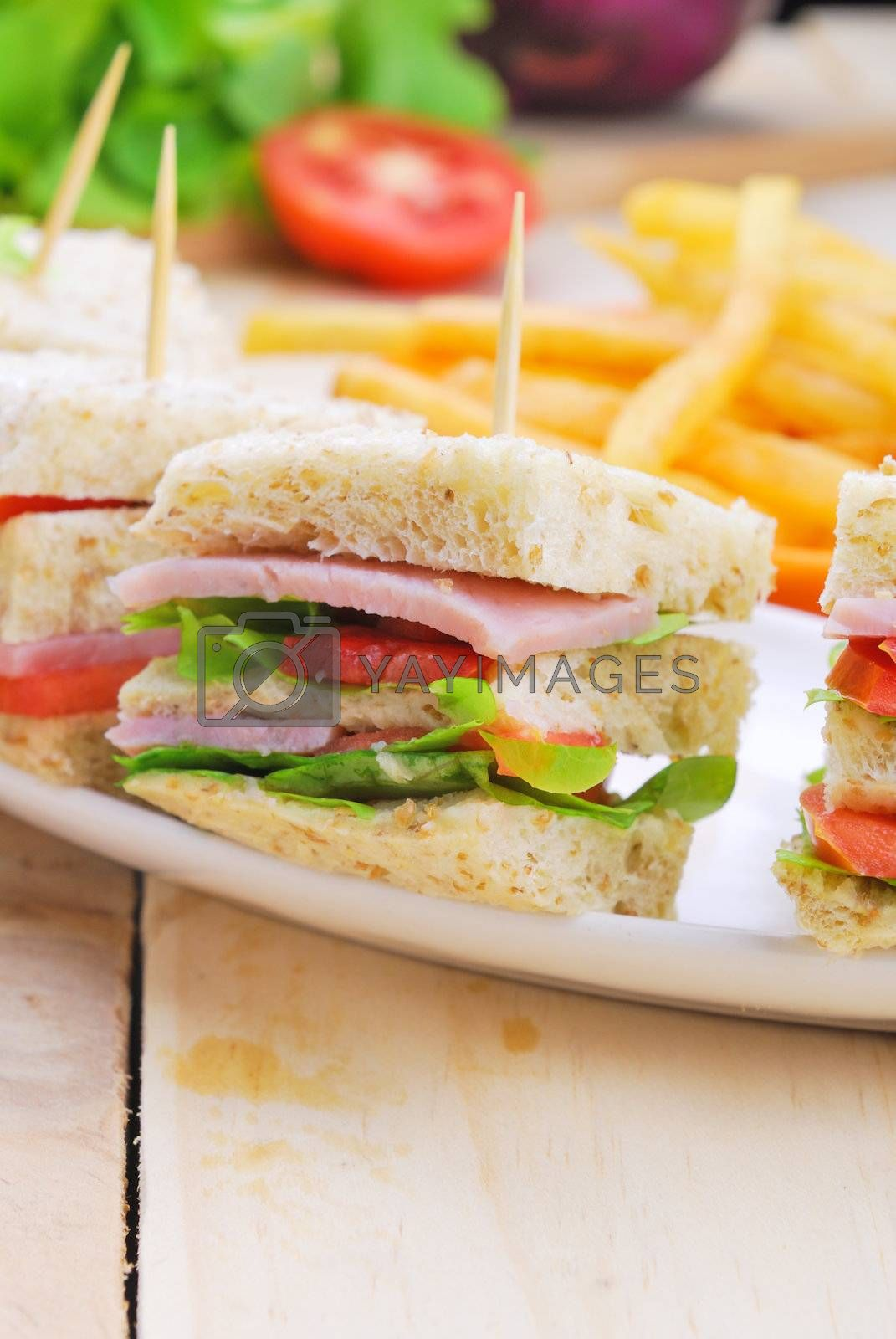 Royalty free image of Club Sandwich with Cheese, Pickled Cucumber, Tomato and ham. Gar by teen00000