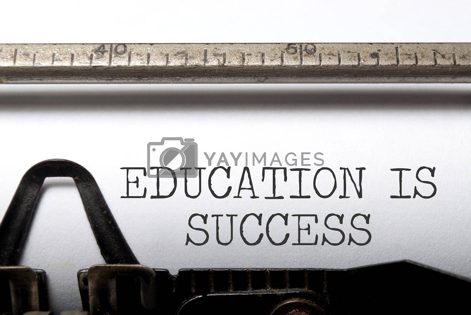 Education is success printed on a vintage typewriter