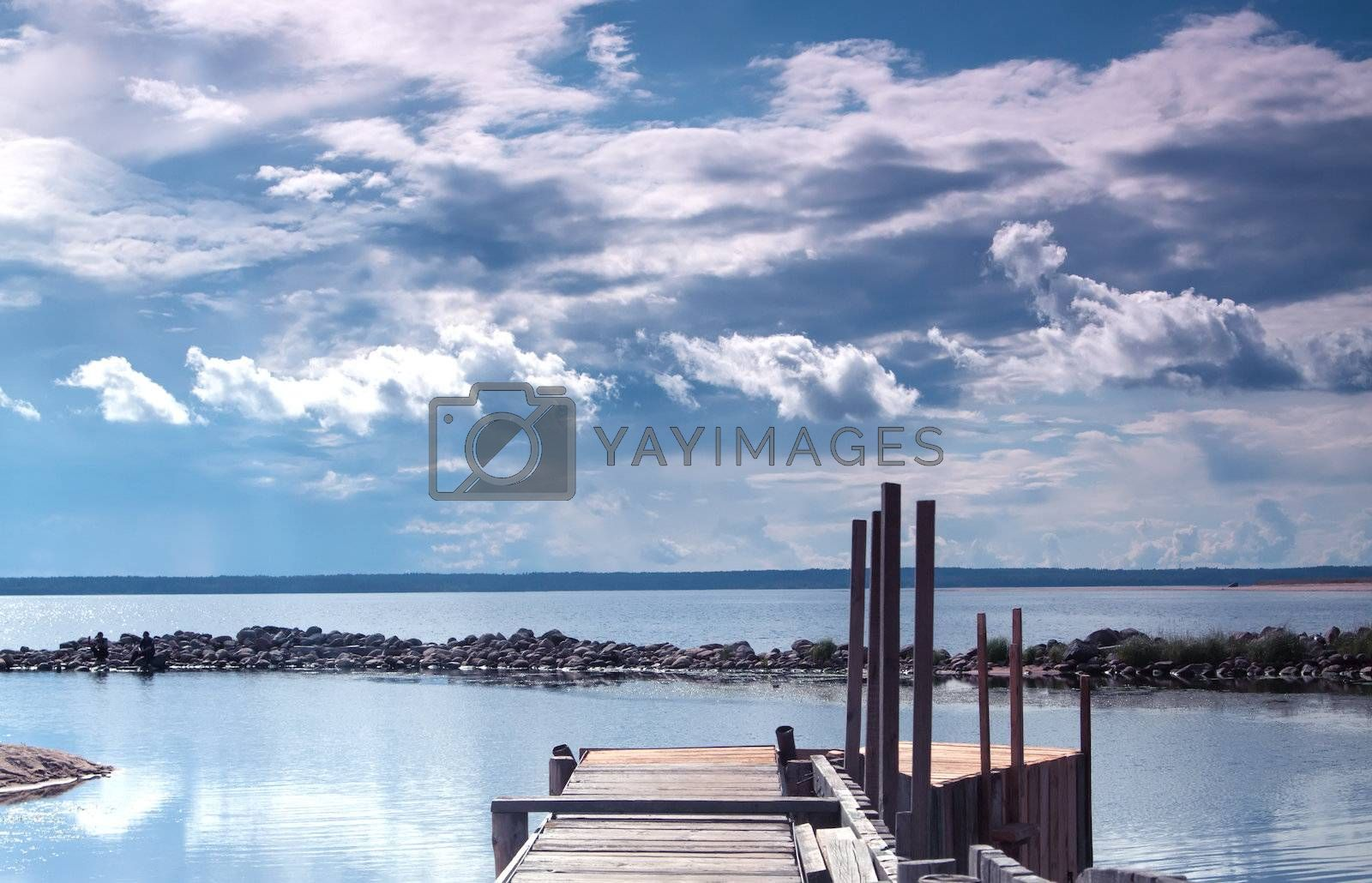 Royalty free image of Old wooden pier by Edoma