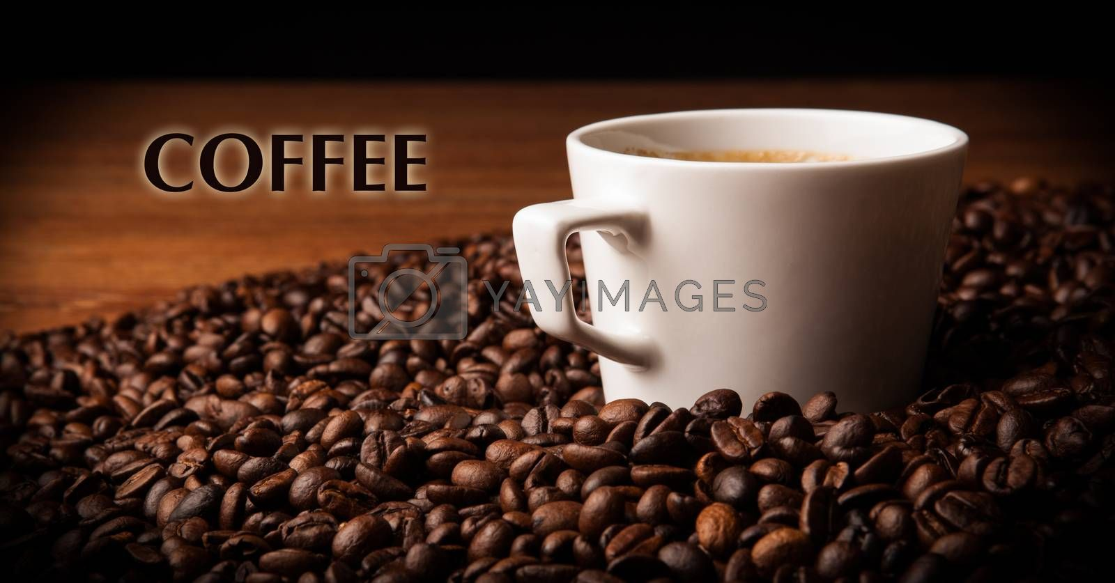 Royalty free image of cup of black coffee with roasted coffe beans by mizar_21984
