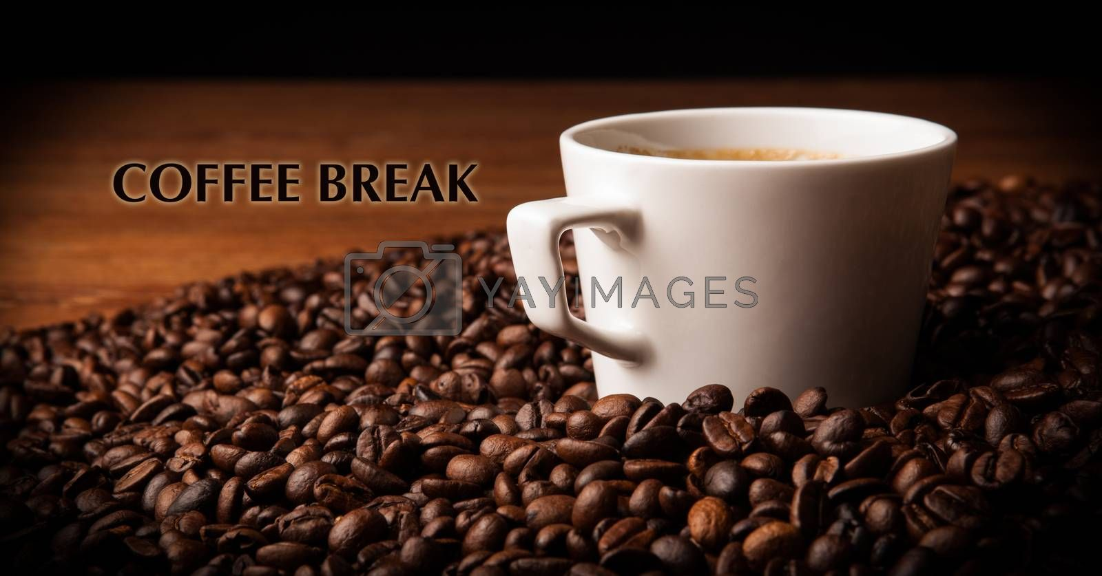Royalty free image of cup of black coffee with roasted coffe beans with title coffee b by mizar_21984
