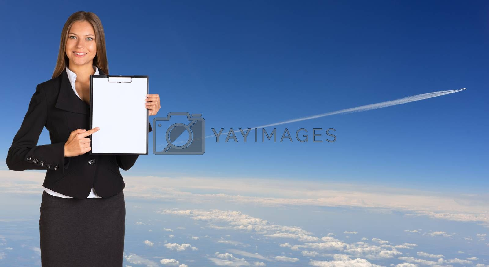 Businesswoman holding paper holder. Airplane trace over the clouds as backdrop