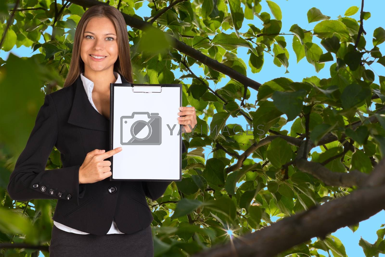 Royalty free image of Businesswoman holding paper holder by cherezoff
