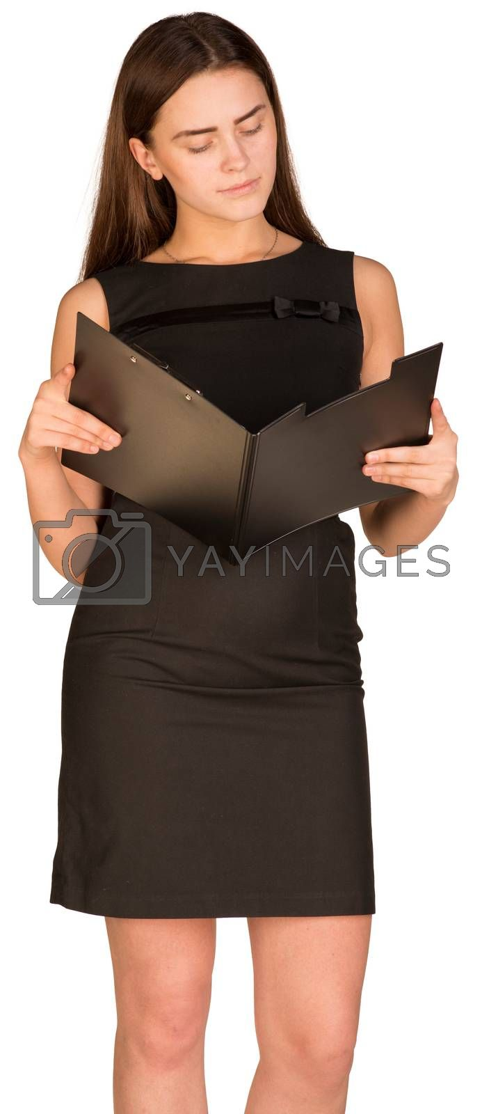 Royalty free image of Businesswoman looking in open paper folder by cherezoff
