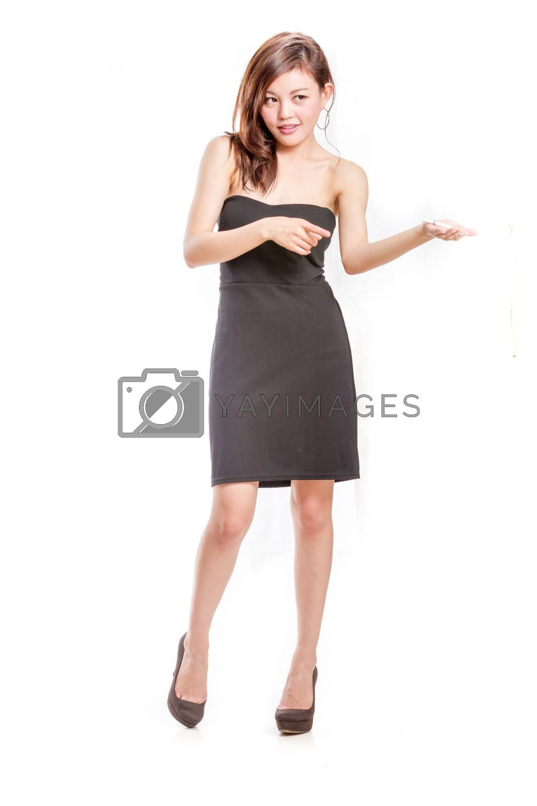 Royalty free image of Chinese woman in black dress offering cigarette by imagesbykenny