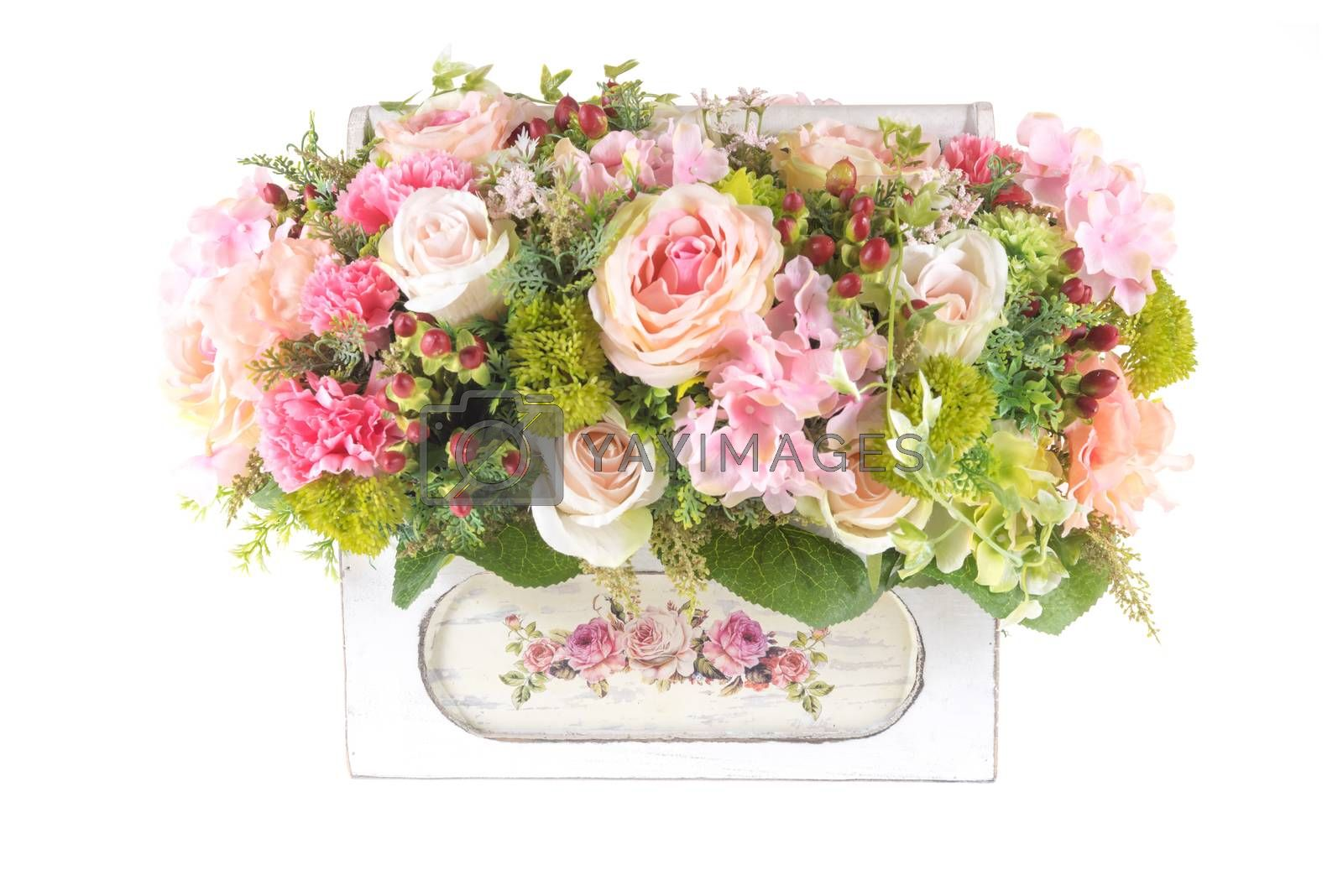 Royalty free image of Decoration artificial plastic flower with vintage design basket by iamway