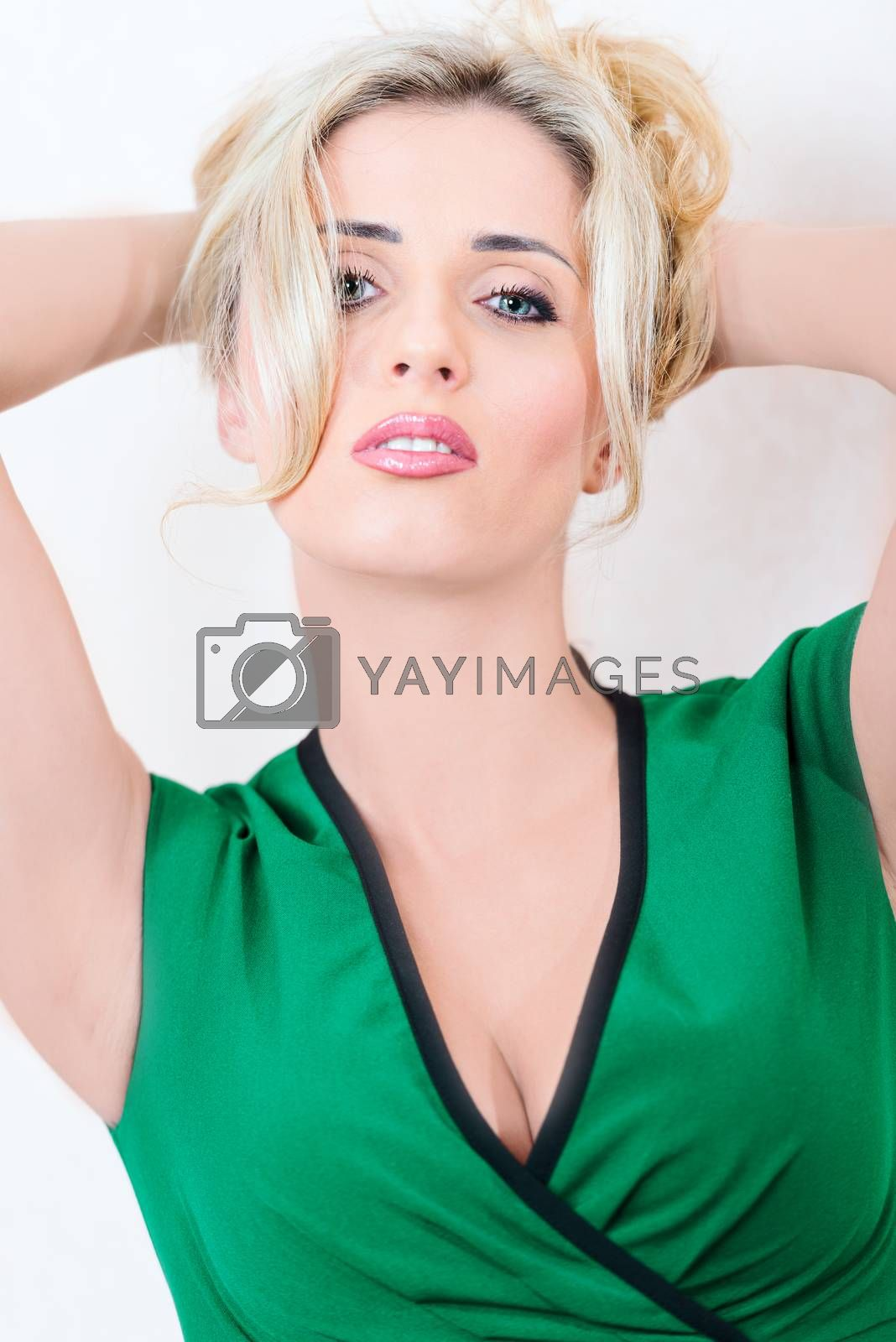 Royalty free image of Blond portrait in dress by Nanisimova